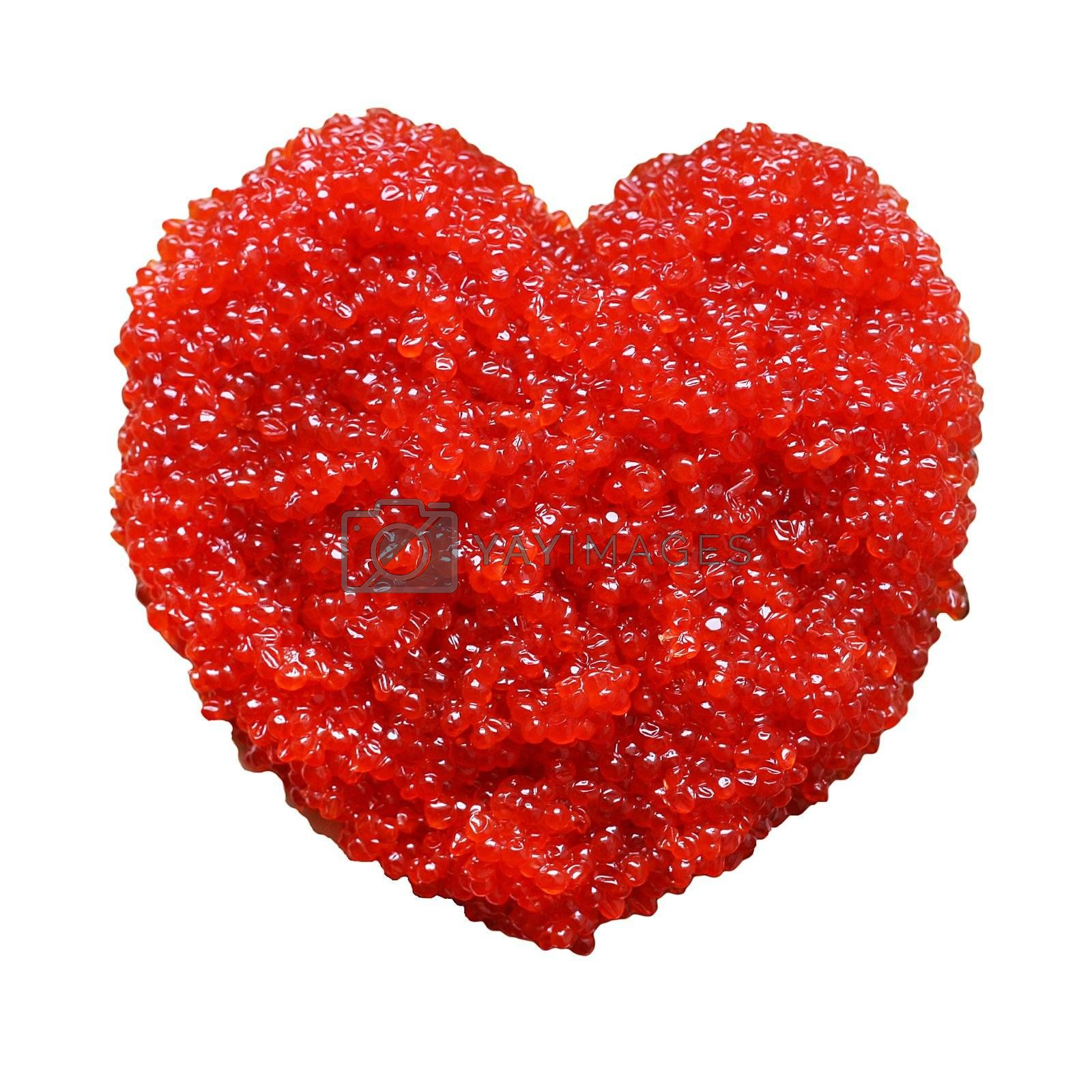 A lot of red caviar in form of heart