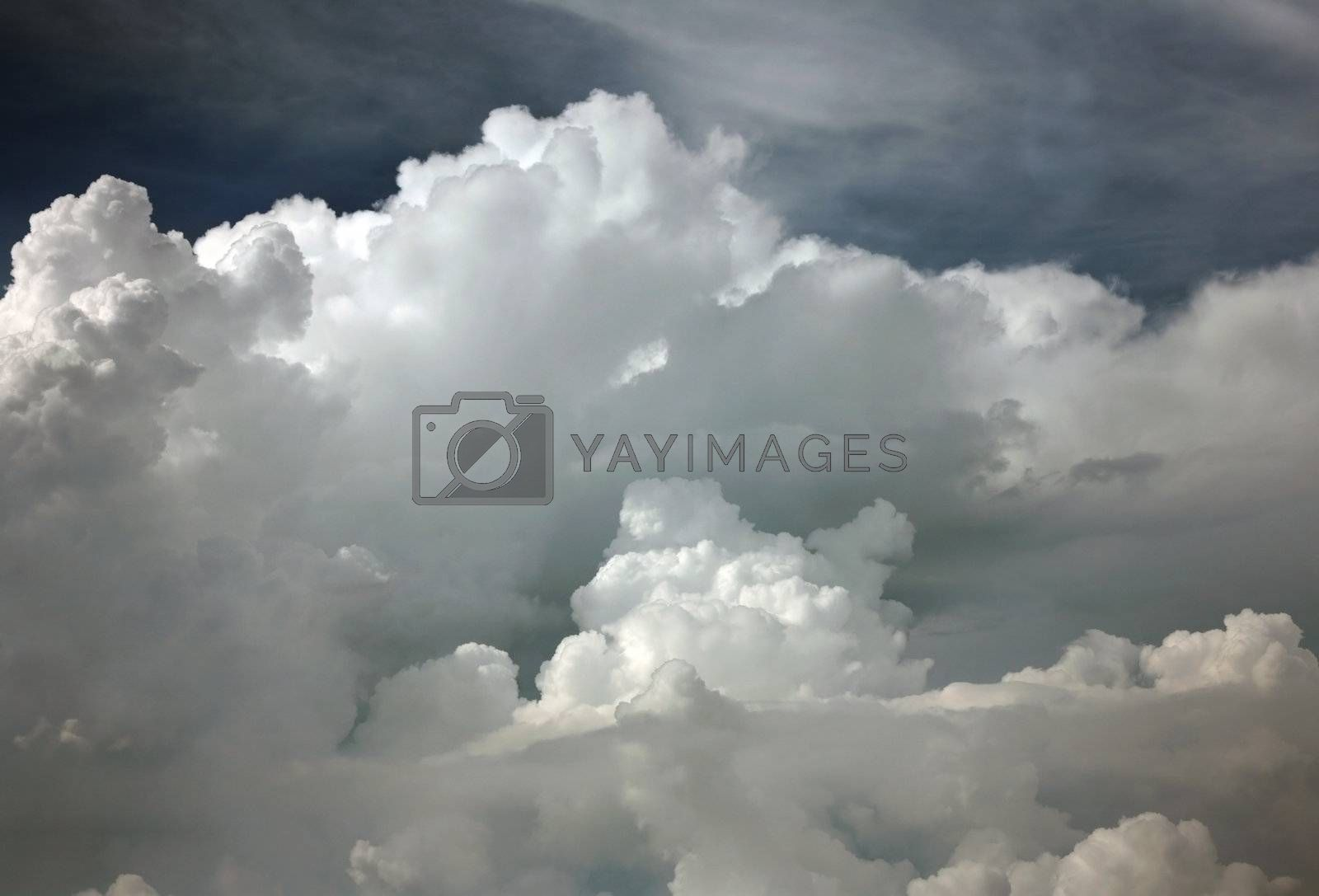 Clouds before a thunder-storm. A view from a window of the plane