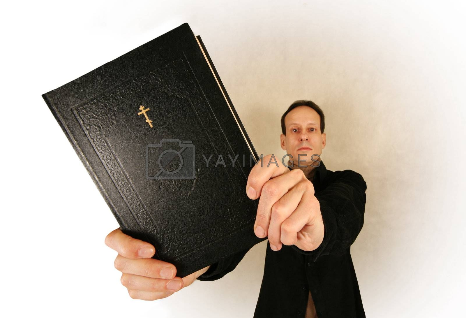 Man with the bible on a light background