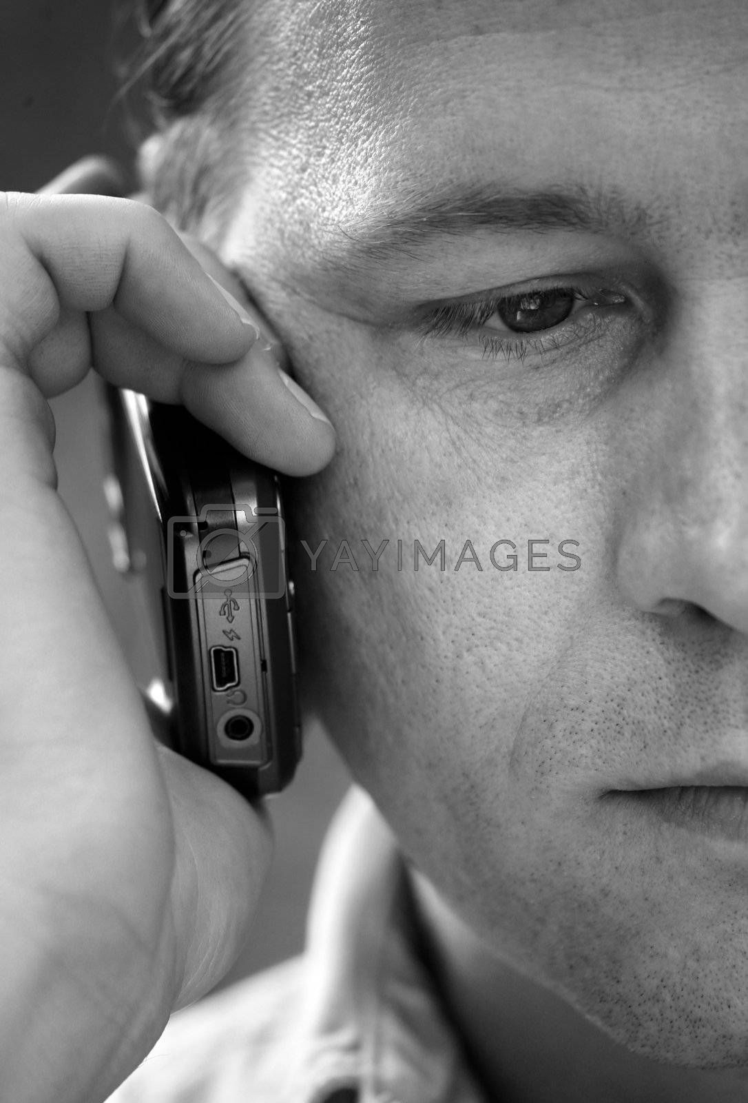 Portrait of the man with the phone close-up