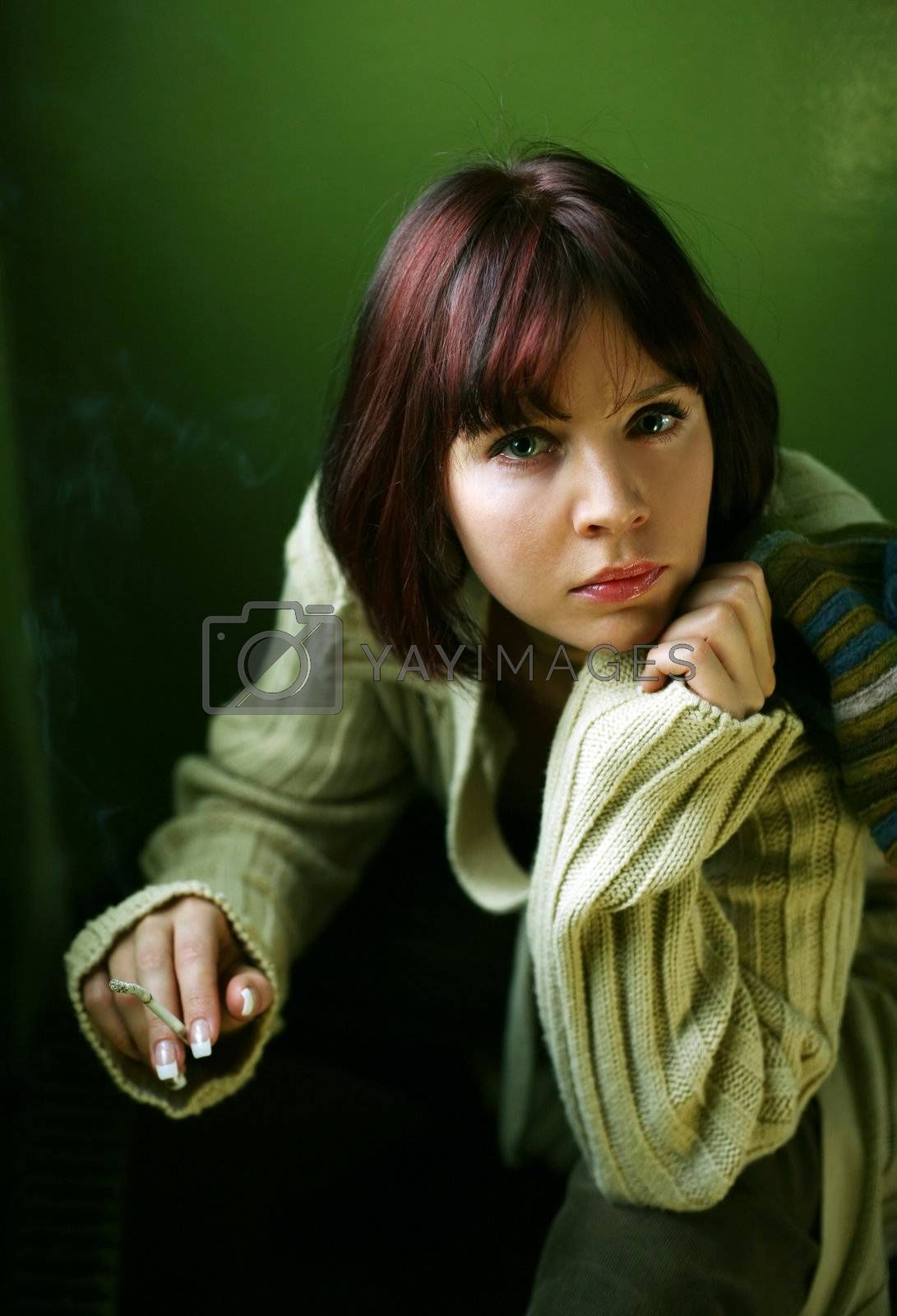 The beautiful brunette gets a light a cigarette