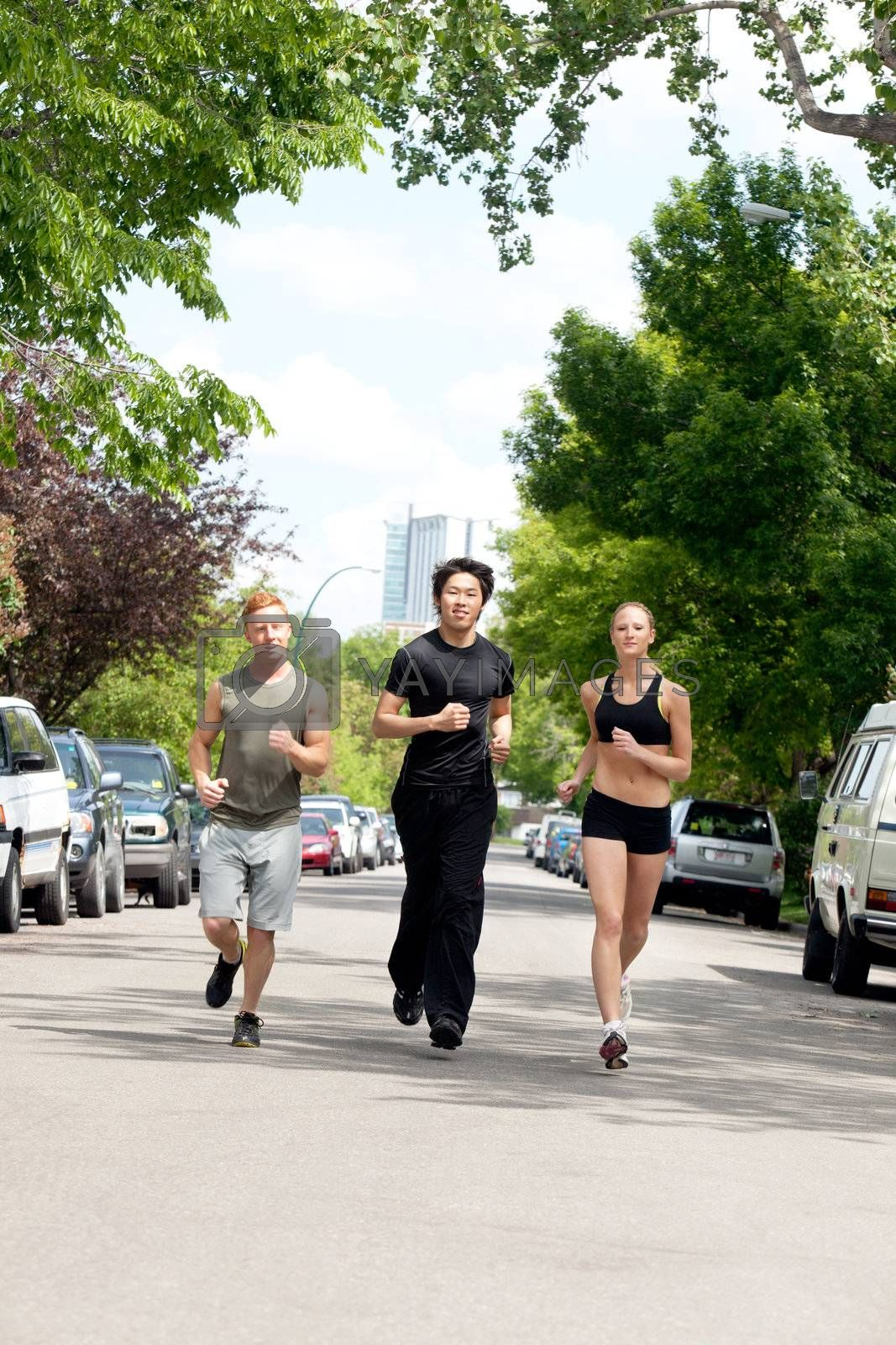 Friends jogging on the street by land vehicle
