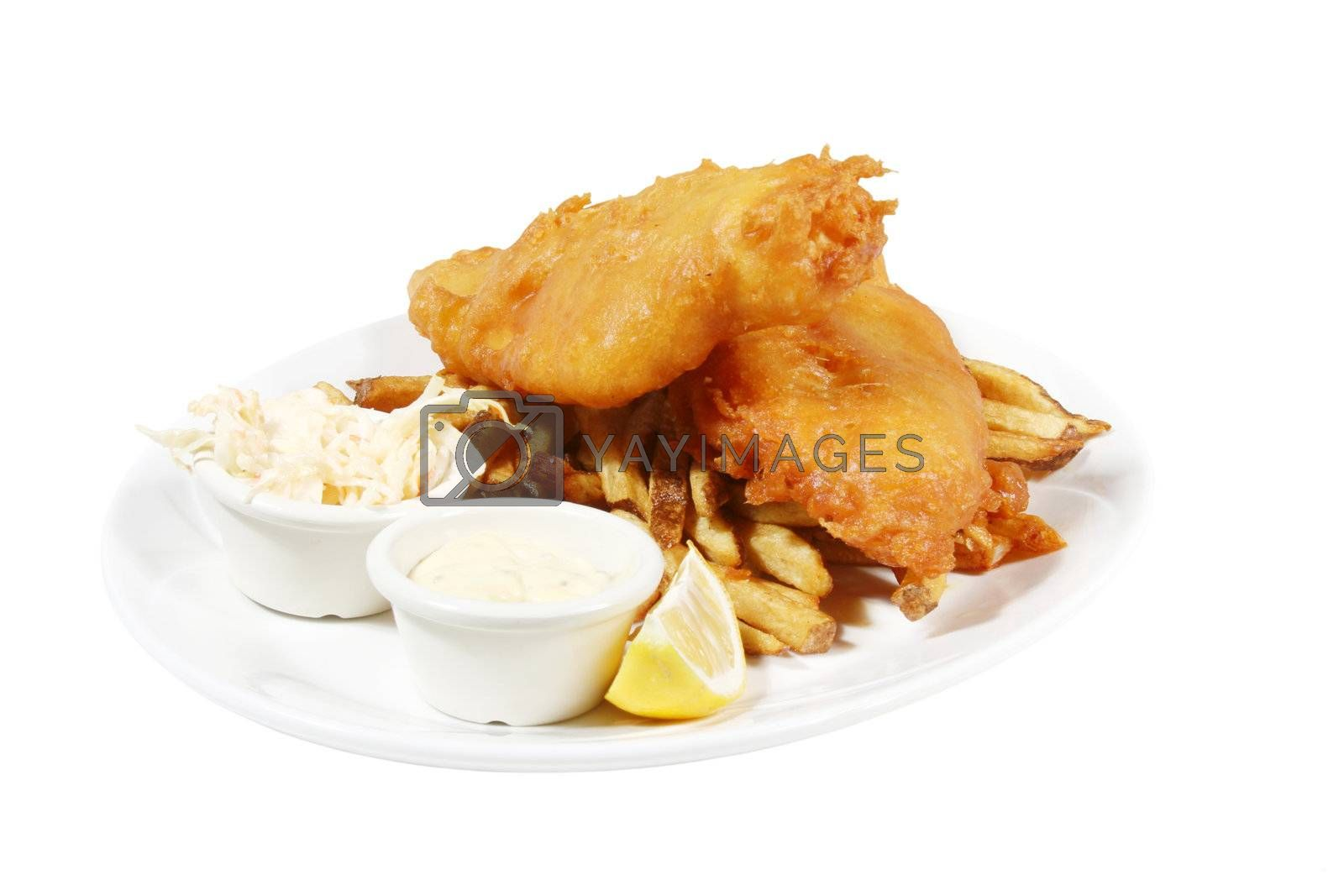 isolated plate of english style fish and chips with tarter sauce and coleslaw