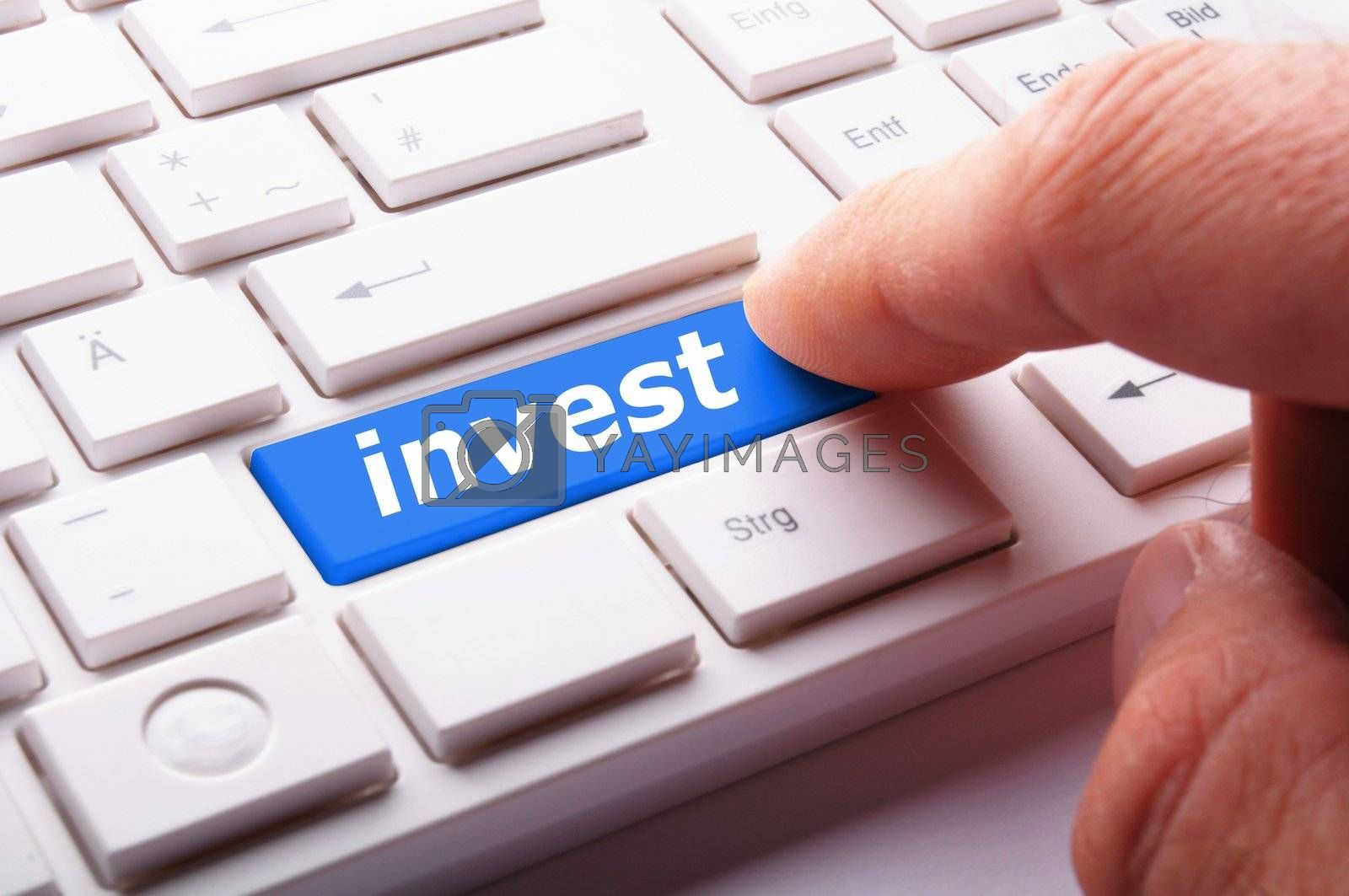 invest key on keyboard showing financial business investment concept