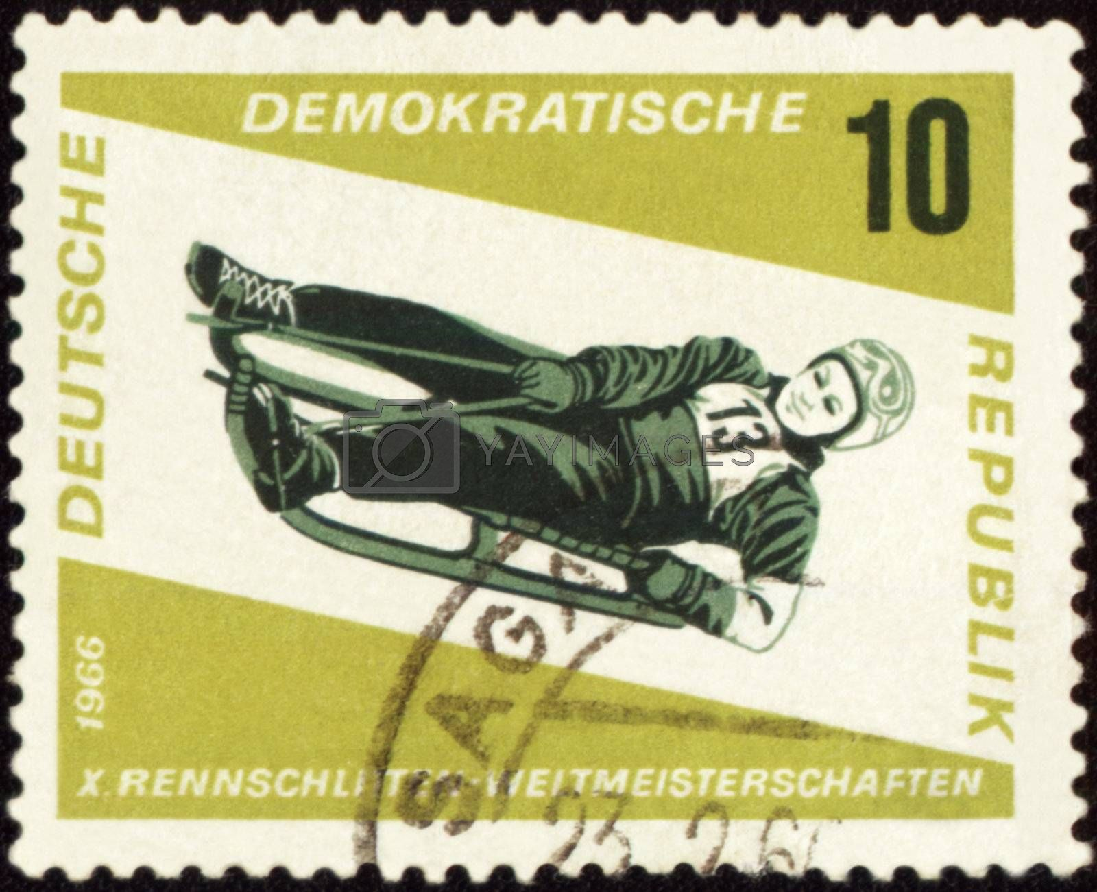 GDR - CIRCA 1966: A stamp printed in GDR (East Germany) shows descent to sledge, circa 1966