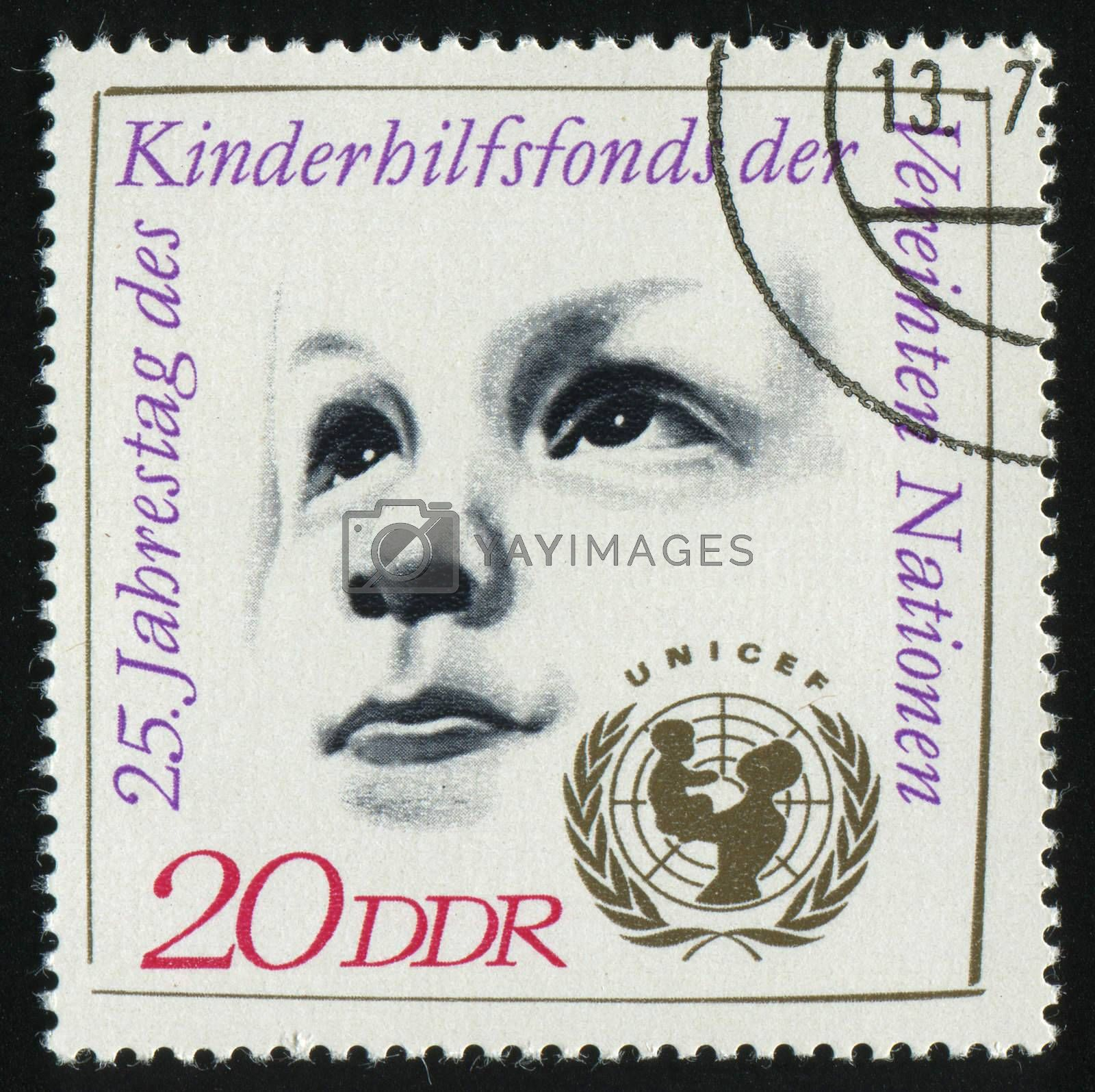 GERMANY- CIRCA 1971: stamp printed by Germany, shows Childs Head, UNICEF Emblem, circa 1971.