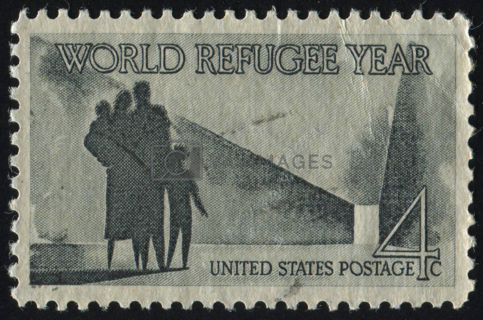 UNITED STATES - CIRCA 1960: stamp printed by United states, shows Refugee Family Walking Toward New Life, circa 1960.
