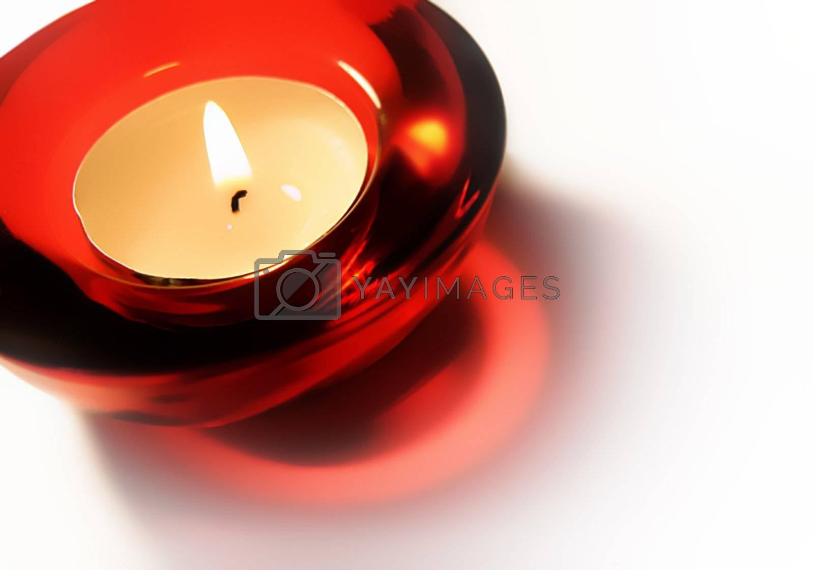 burning candle on a white background