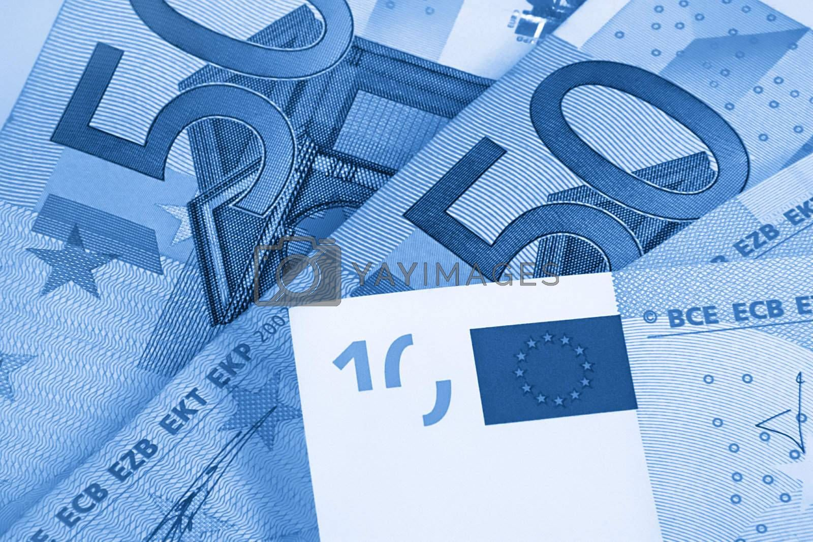 fragment of fifty and ten euro money, blue abstract background