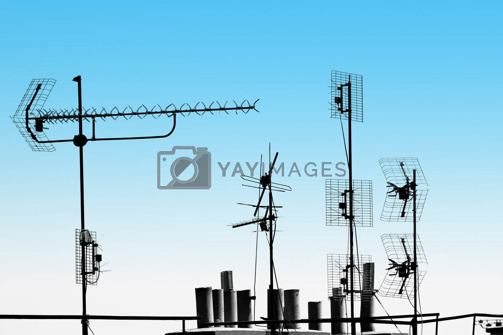 television antennas and pipes on the rooftop