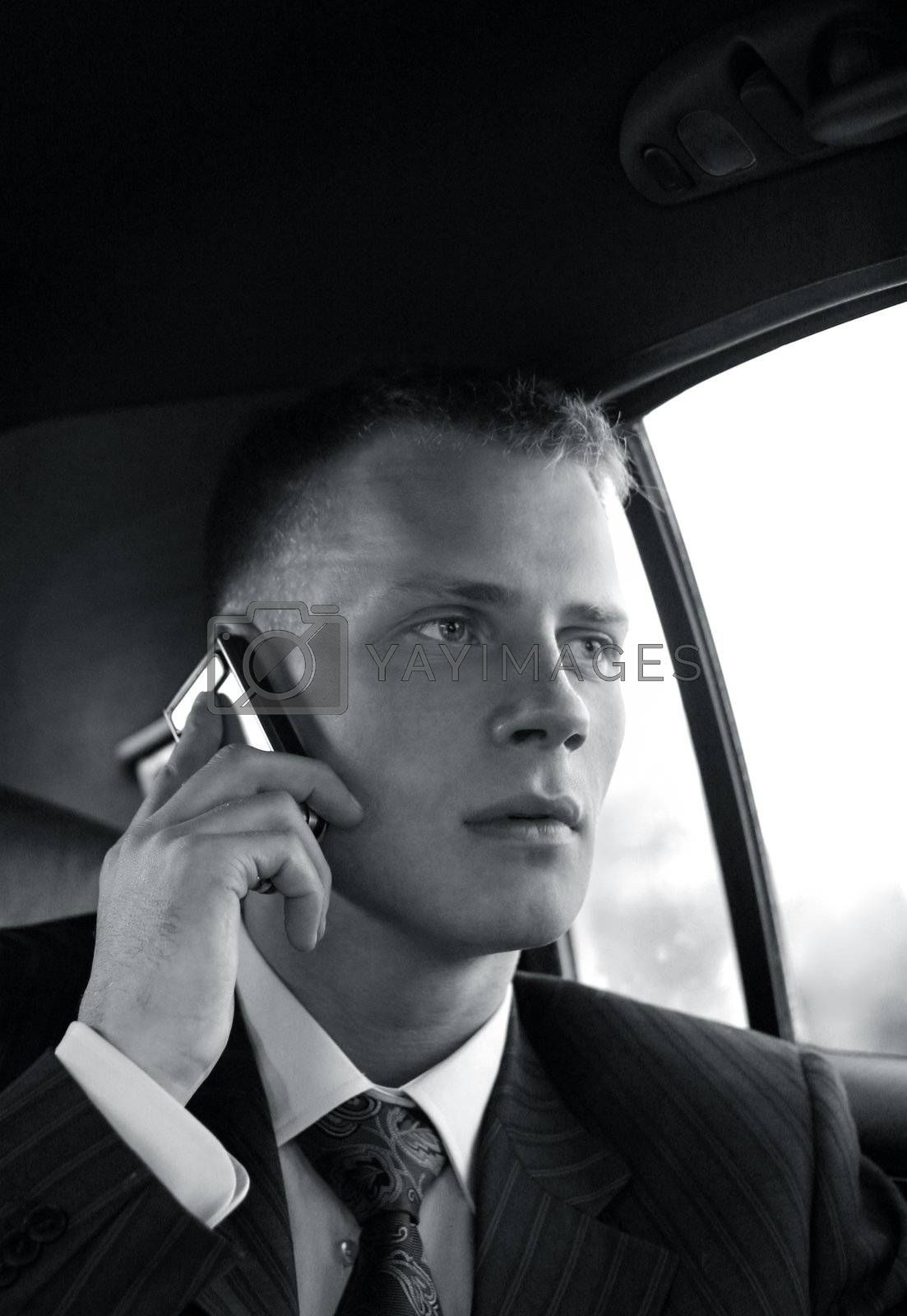 The puzzled young man speaks by the phone