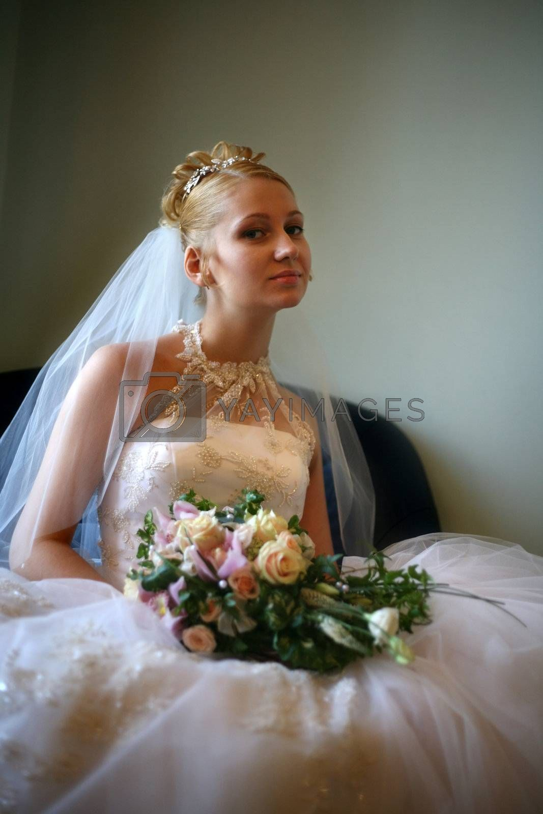 Portrait of the beautiful bride with a bouquet