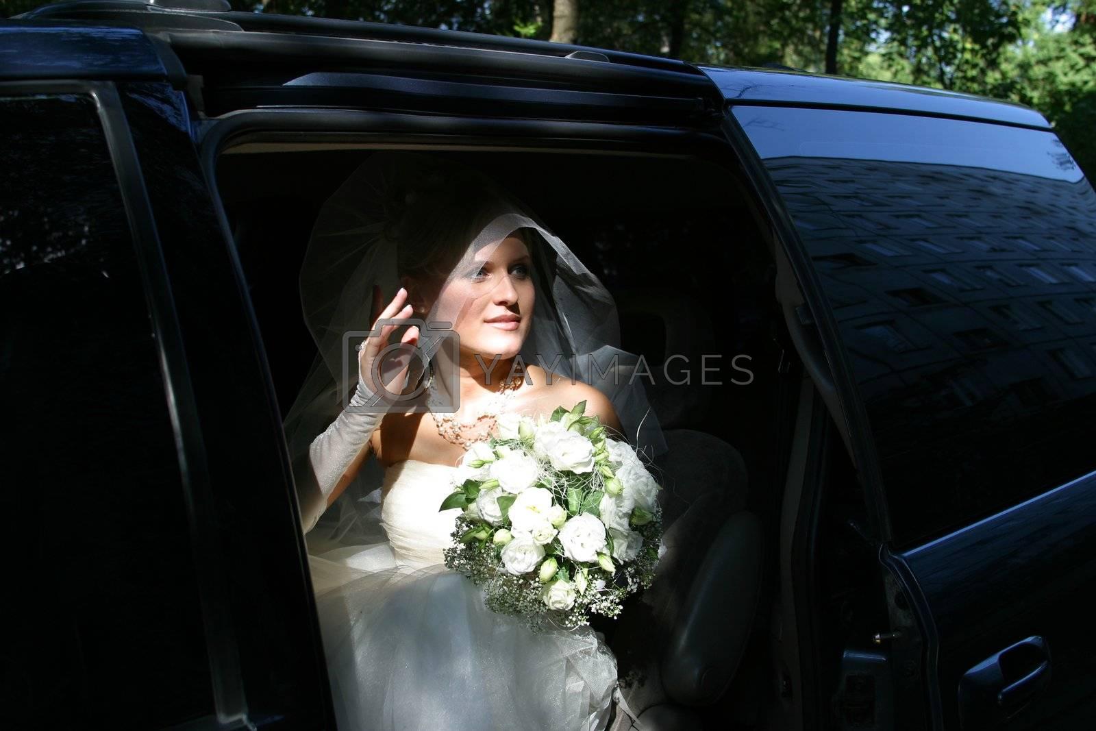 The beautiful bride in a car