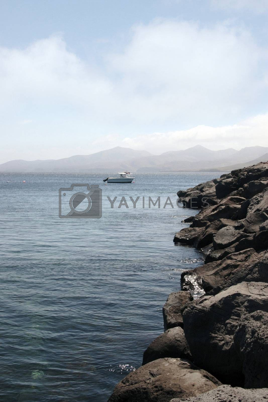 a motor boat in clear blue waters