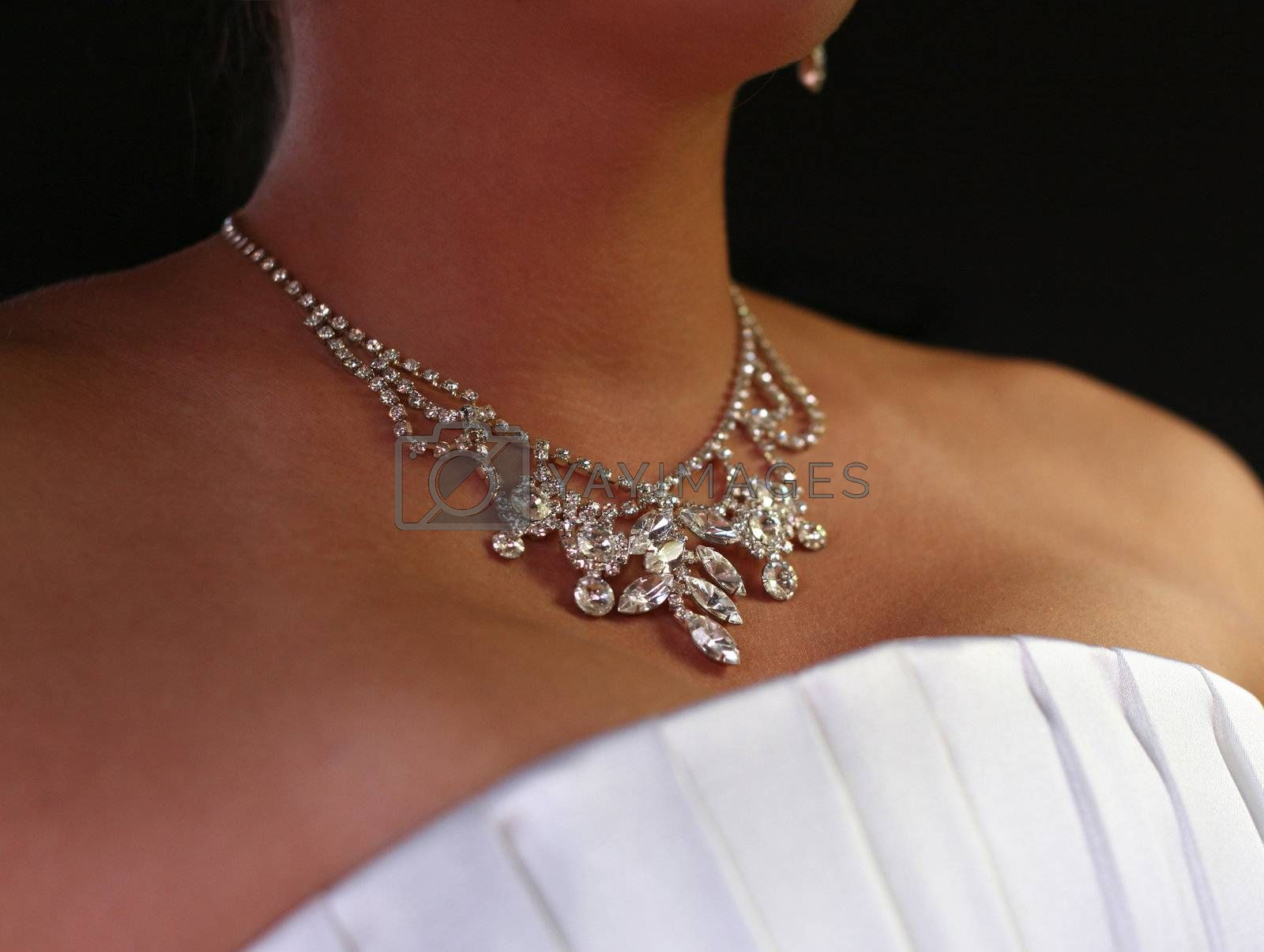 Wedding diamond necklace on a neck of the bride