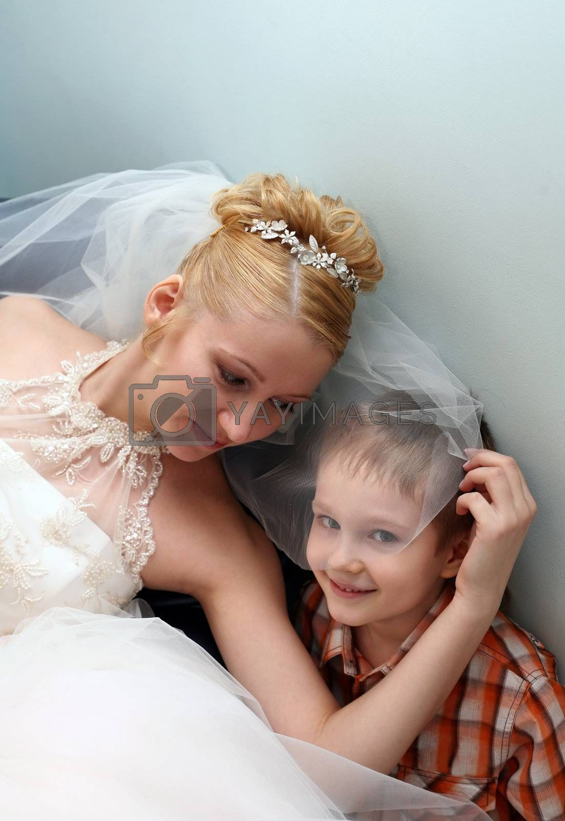 The beautiful bride with the little boy