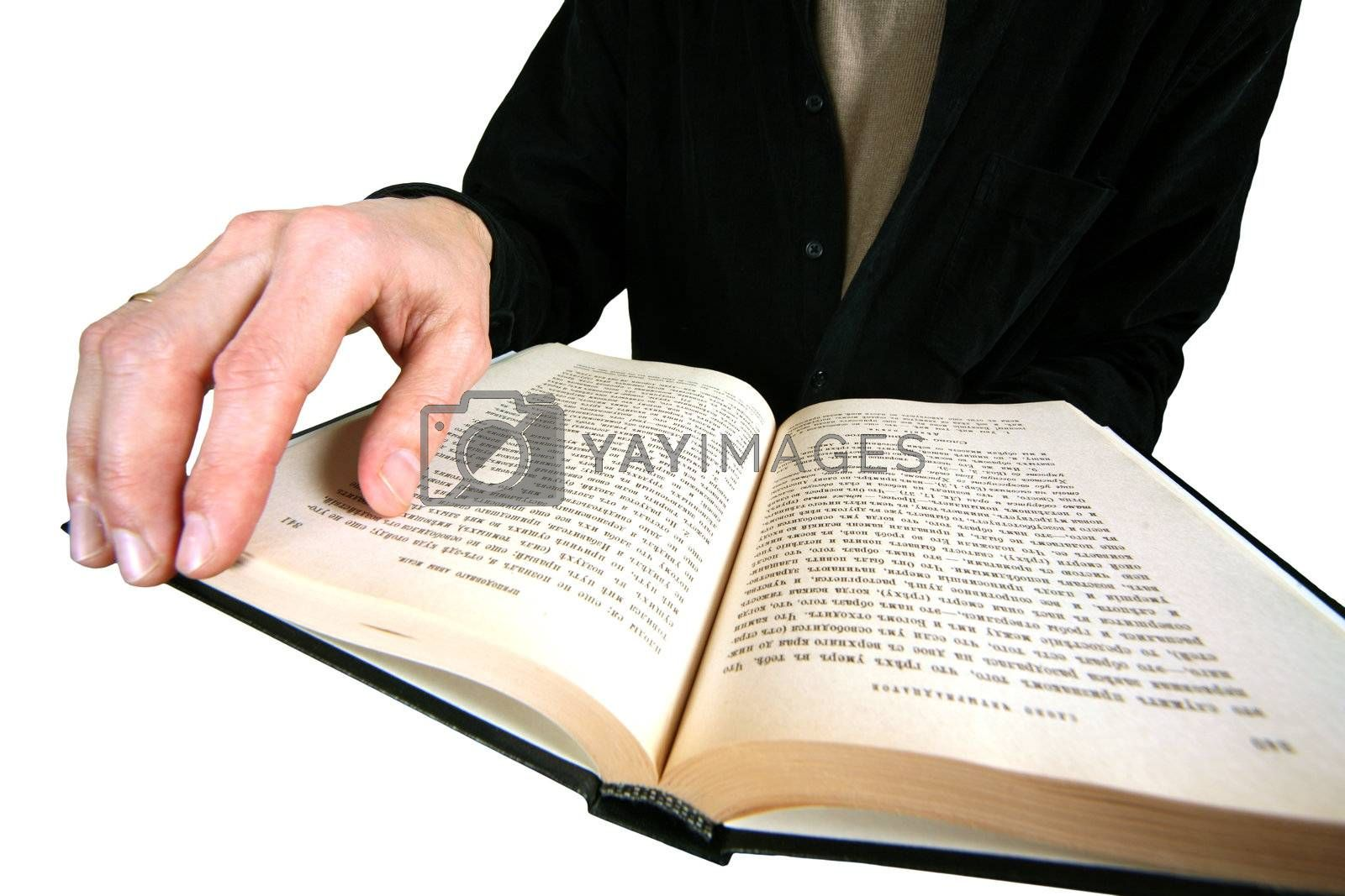 The male hand holds the open book