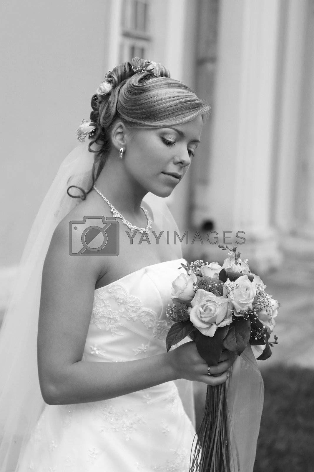 The beautiful bride with a bouquet from roses. b/w