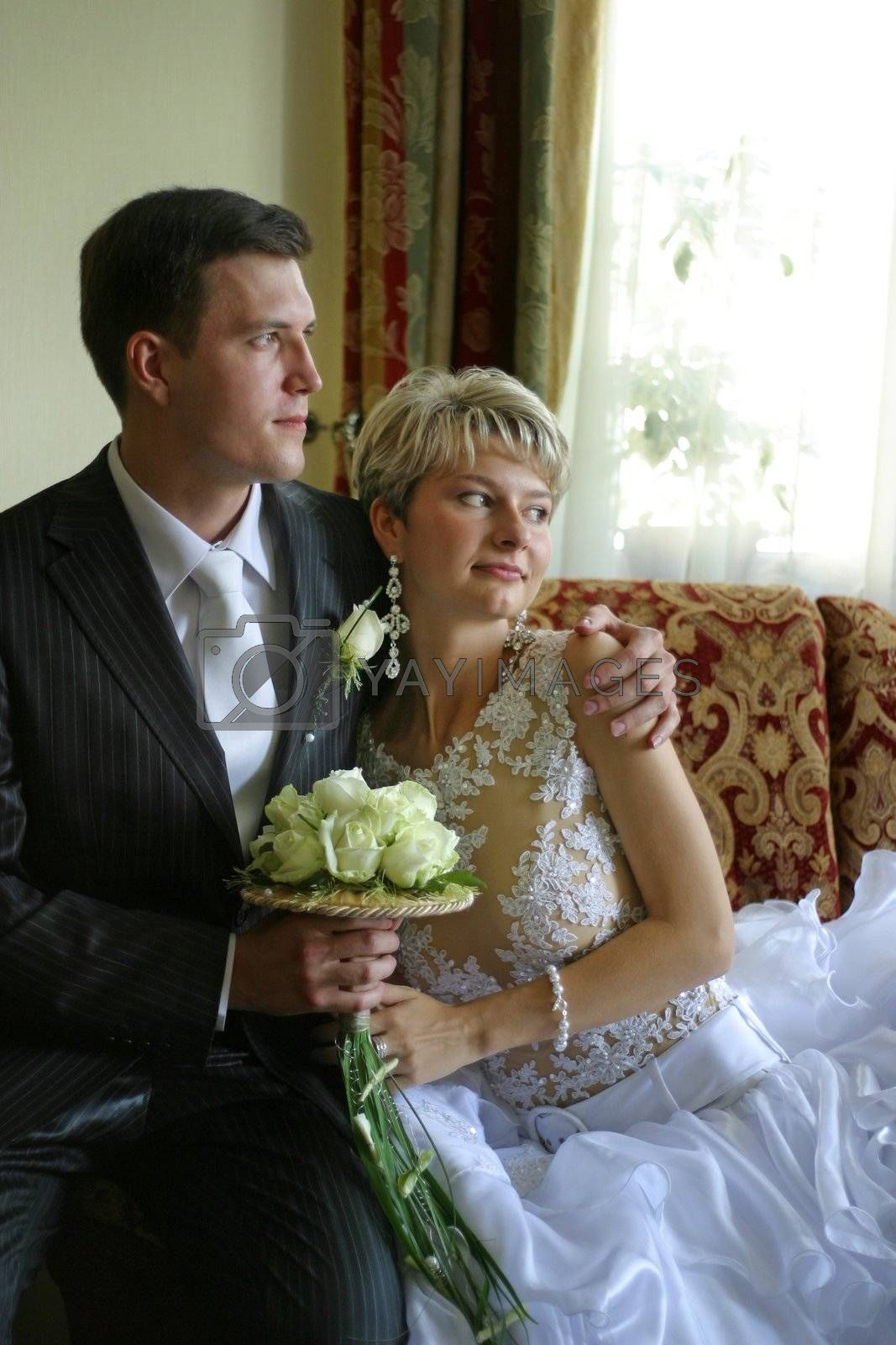 Newly-married couple in an interior