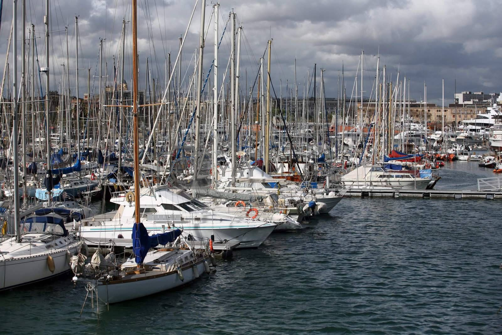 Tall luxury boats and yachts moored in duquesa Port In Spain, Barcelona