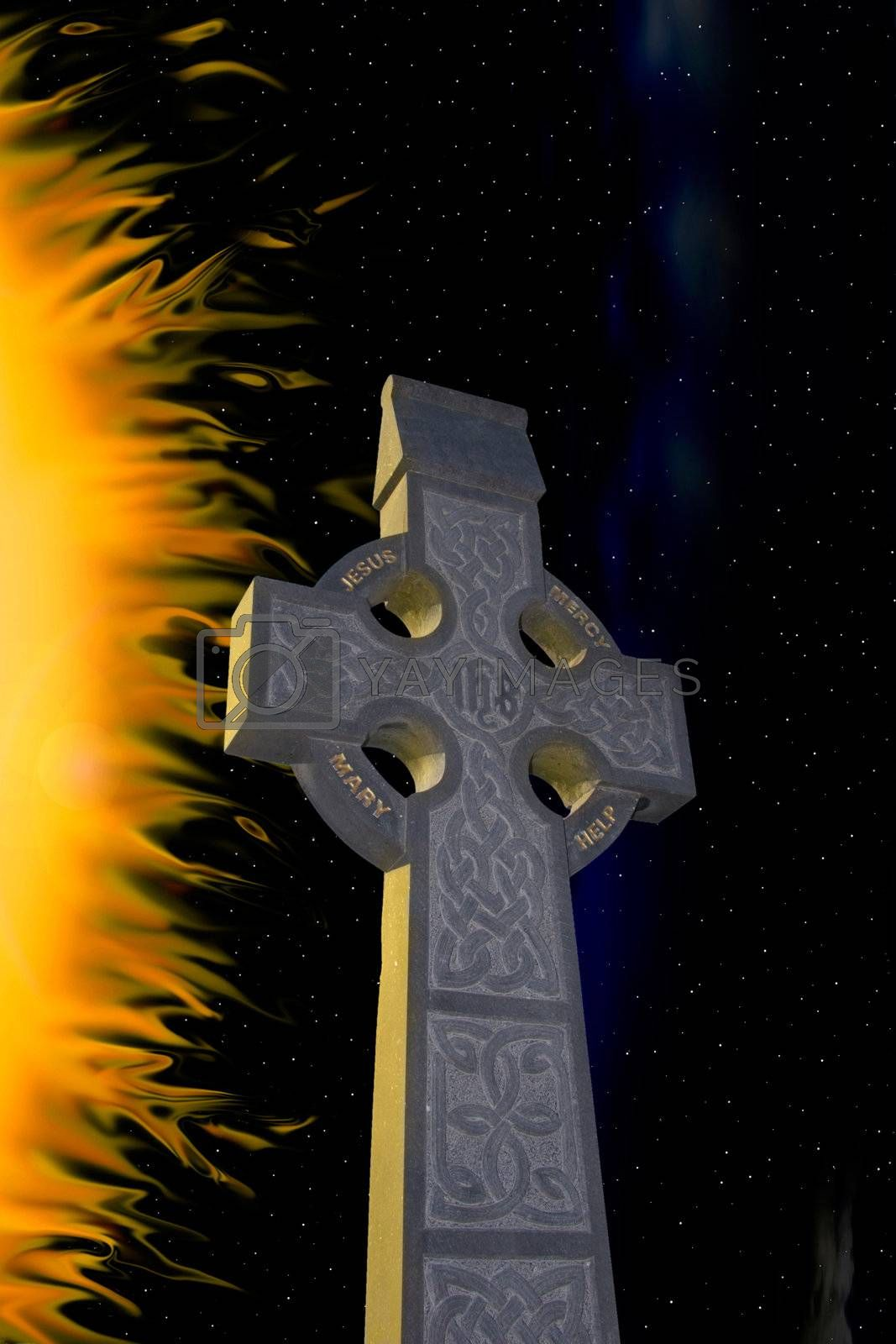 celtic cross against a starry flamed night