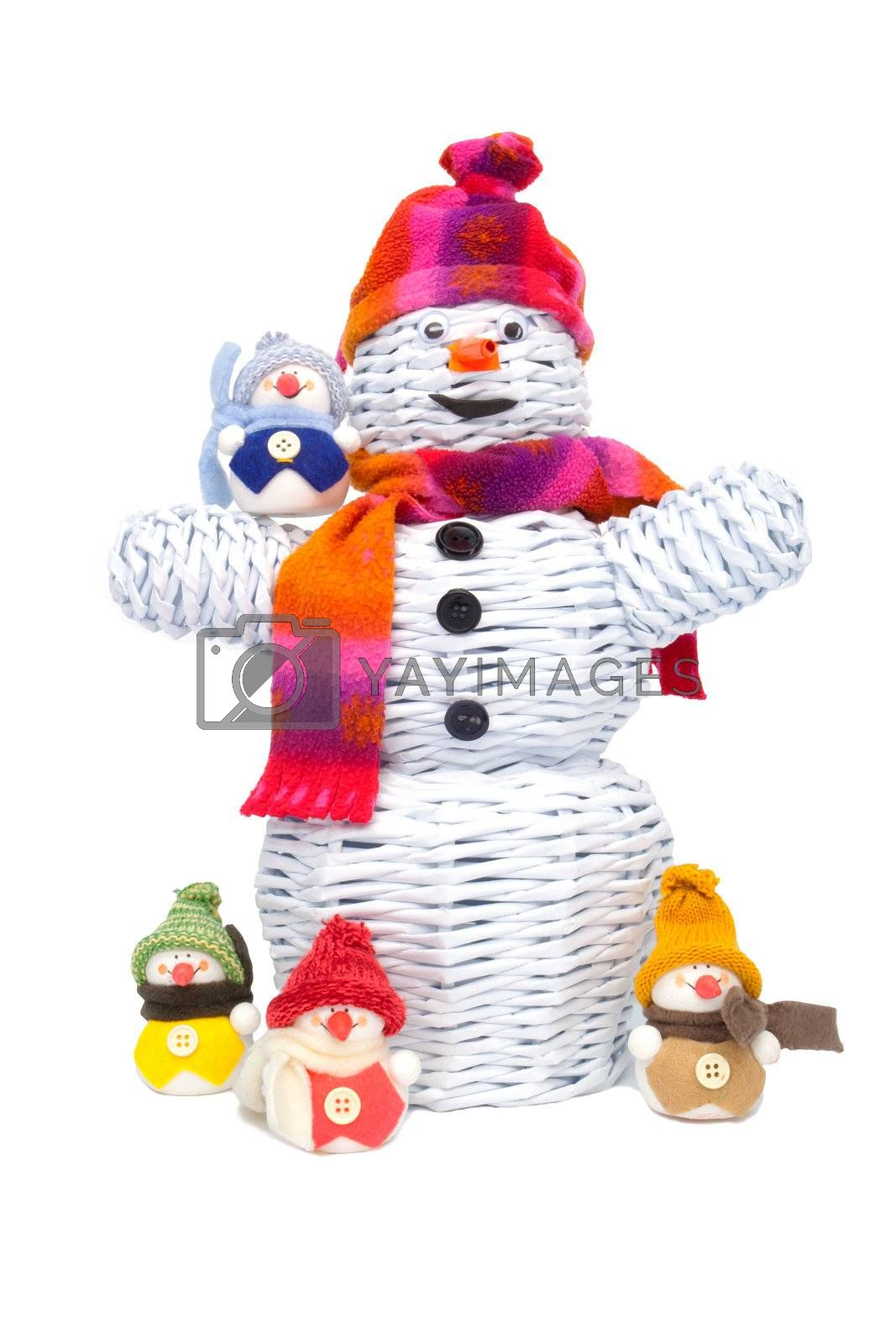 Great knitted snowman made from paper and other smaller snowmen around like children.