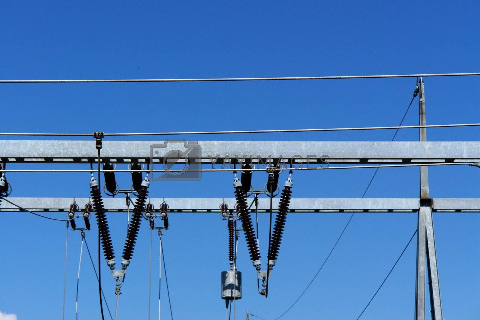 a utiliy pole against a blue sky