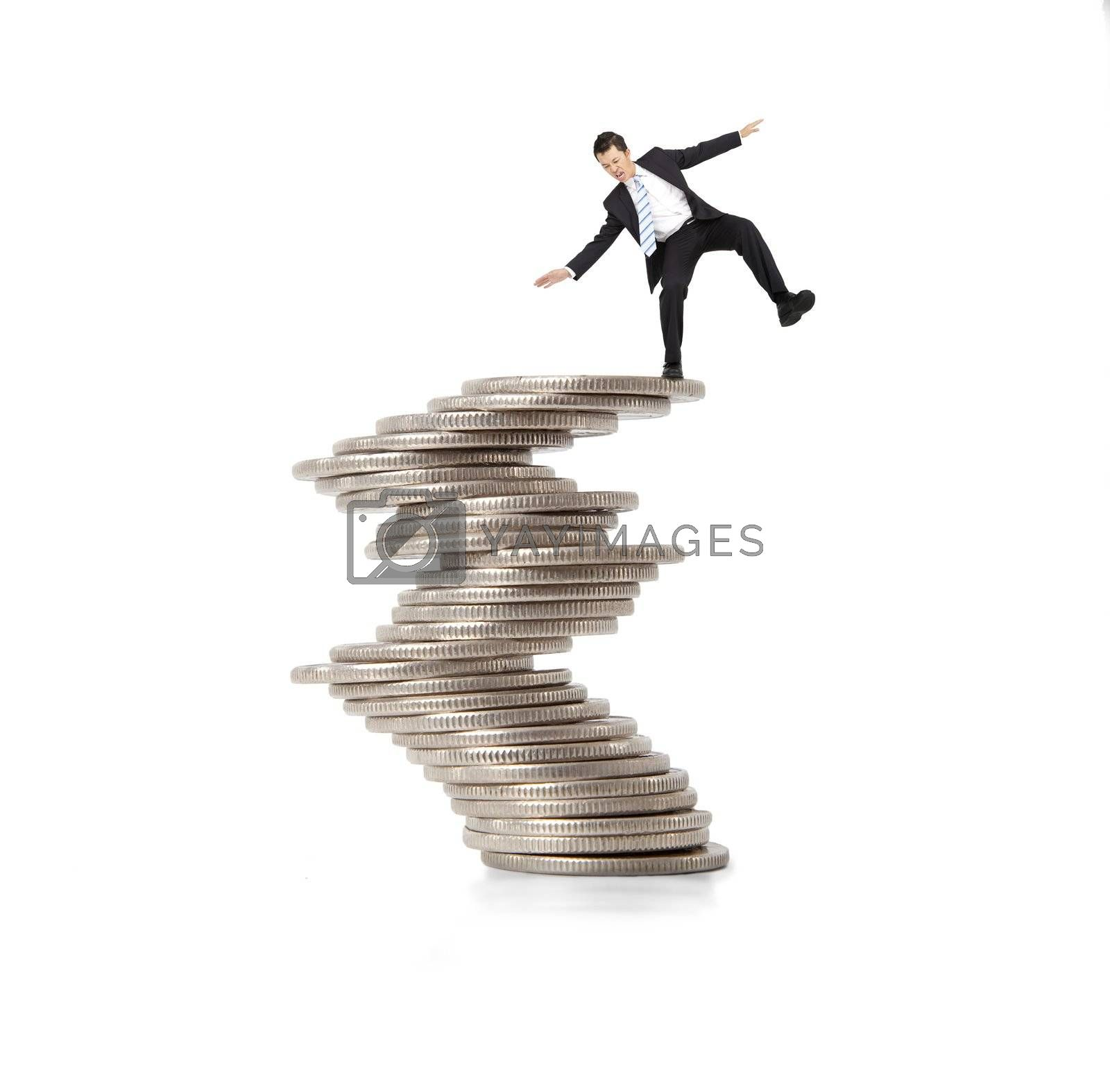 financial and crisis concept. businessman standing on the unstable coins