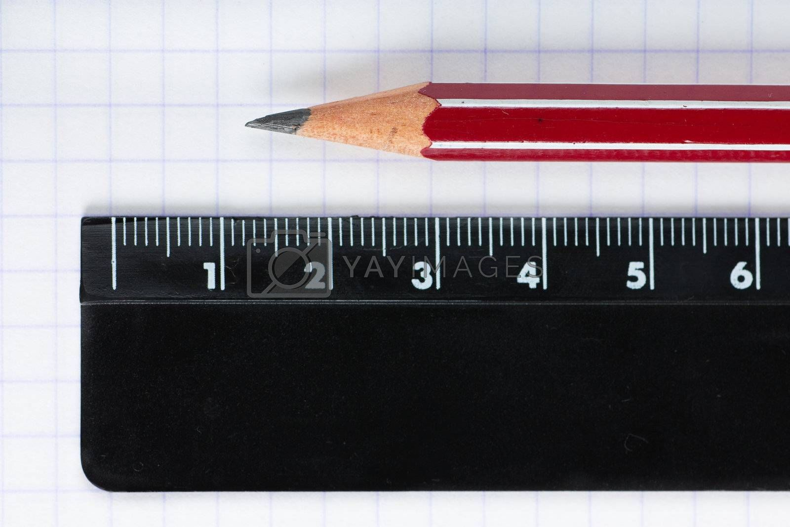 Macro view of pencil and ruler on exercise book page