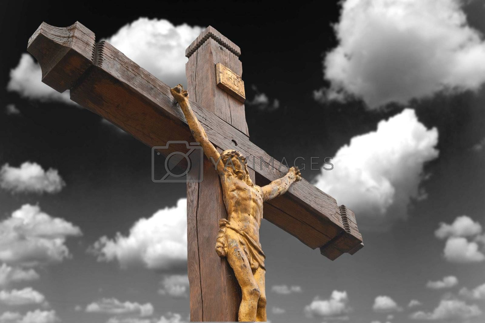 The crucifixion from a tree with Jesus's gilt figure. Drame sky