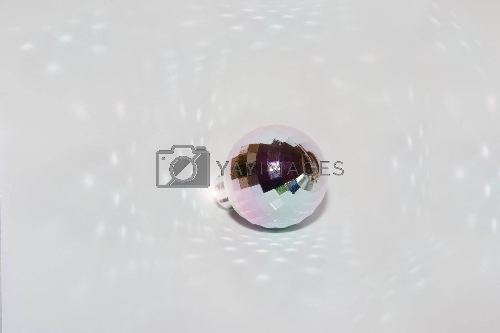 a disco ball with reflections on bright background