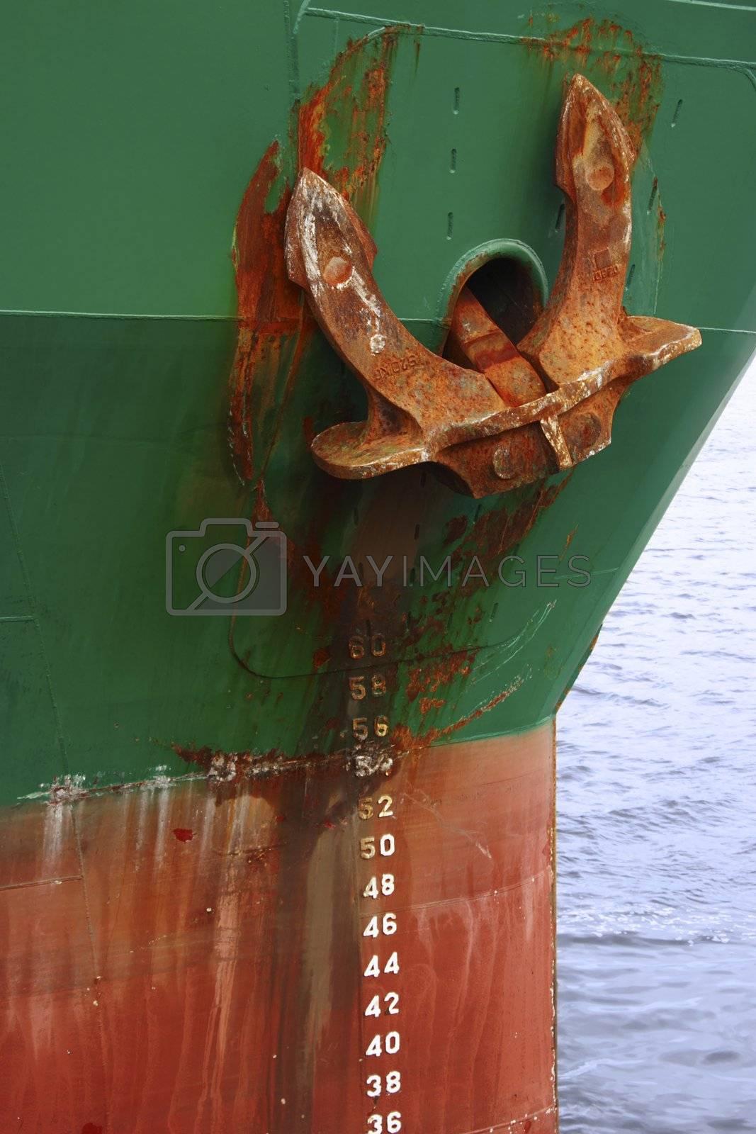 steel cargo ship docked in the bay