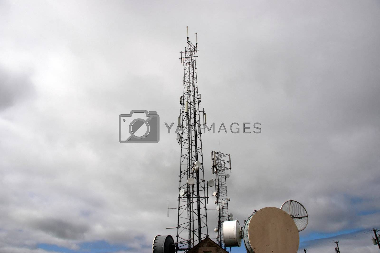 communication masts and dishes on top of a hill