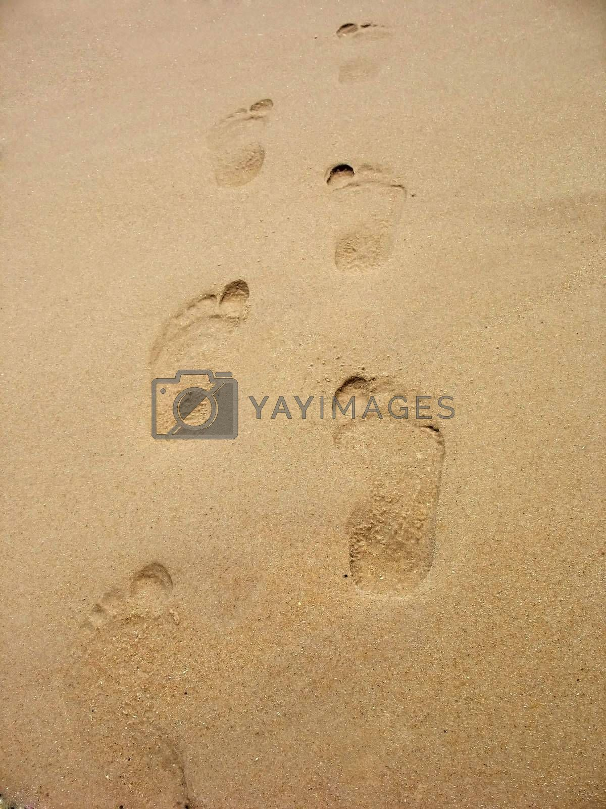 footprints in sand by graficallyminded