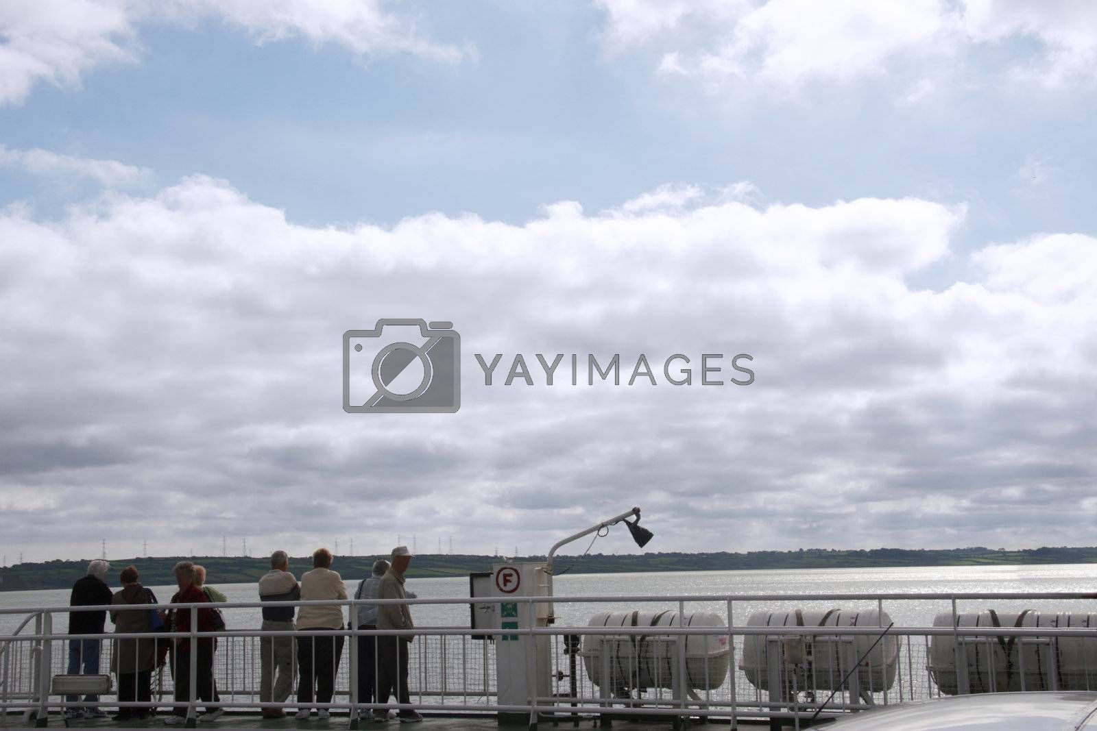 people on the deck of a car ferry