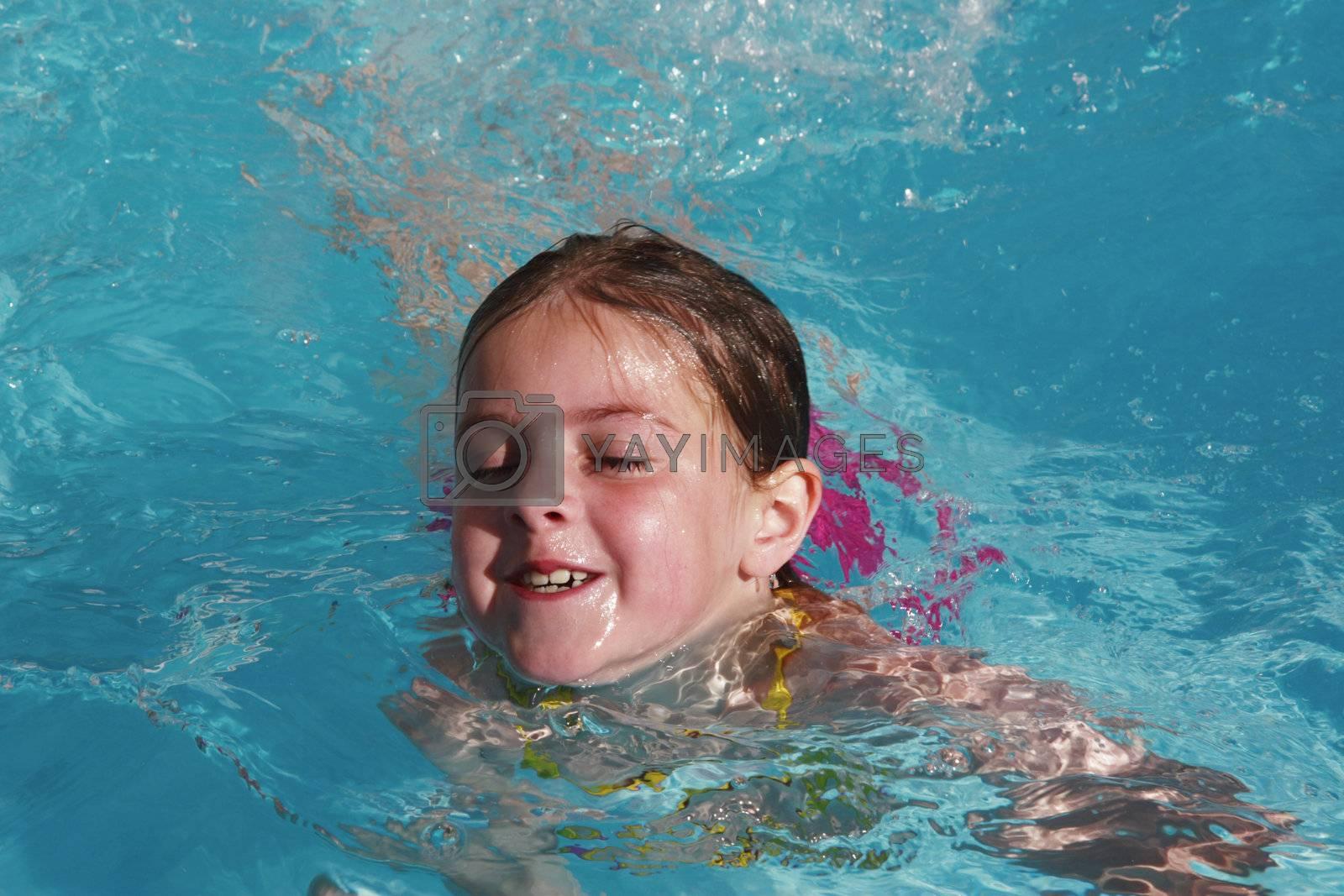 girl having fun just floating in a pool