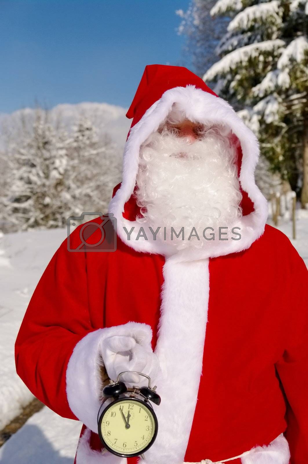 Santa Claus, Father Christmas holds watch clock