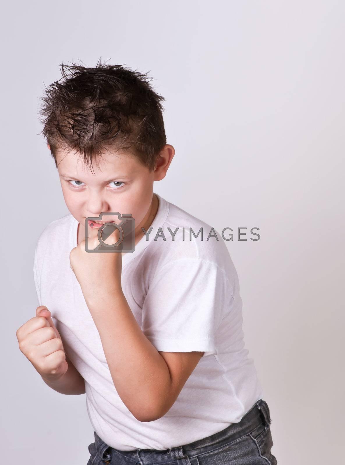 Portrait of emotionally kid. Funny little boy. Beautiful caucasian model.