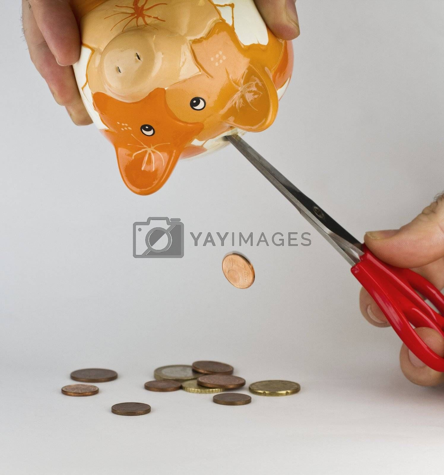 getting money out of piggybank with a cutter. Synonym for financial straits or shortage of money