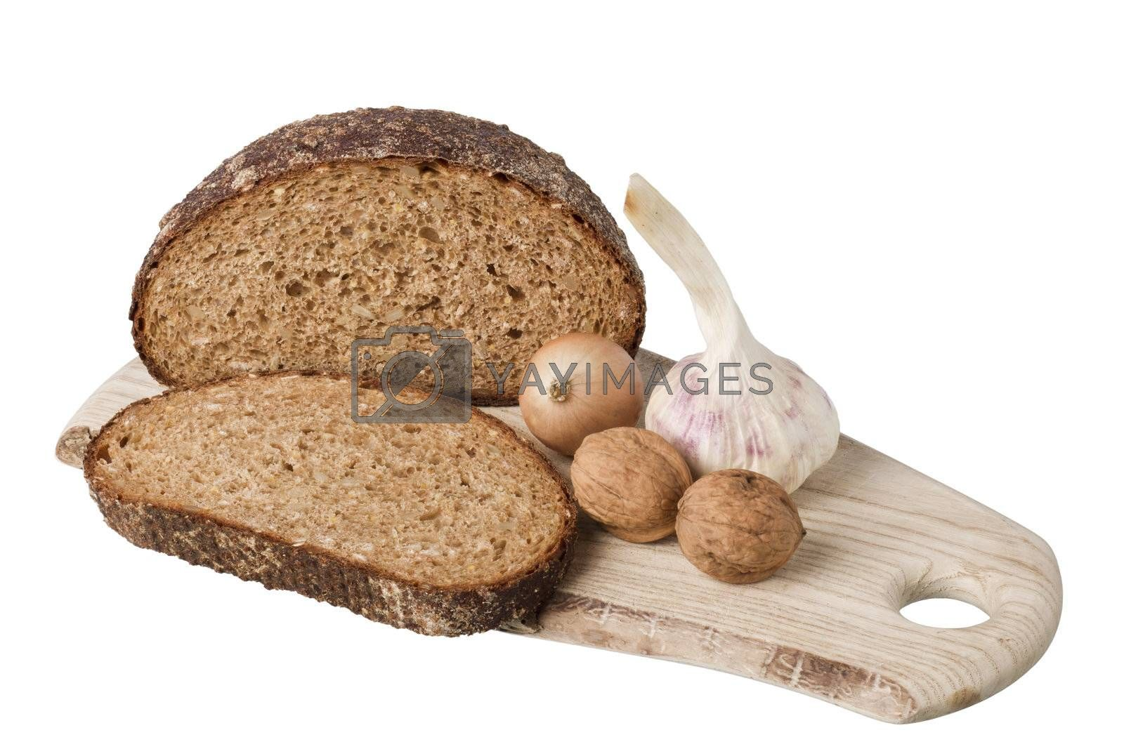 brown bread on shelf with onion, garlic and walnut  isolated on white background