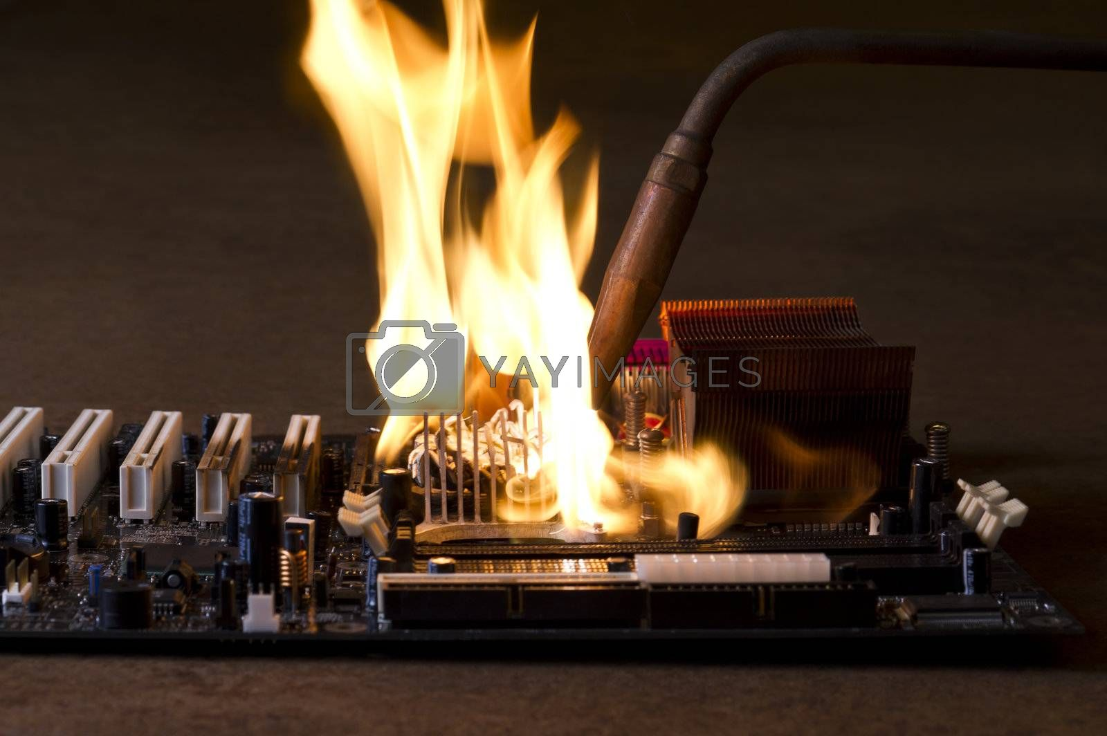 burning computer main board in rusty background. Copyspace