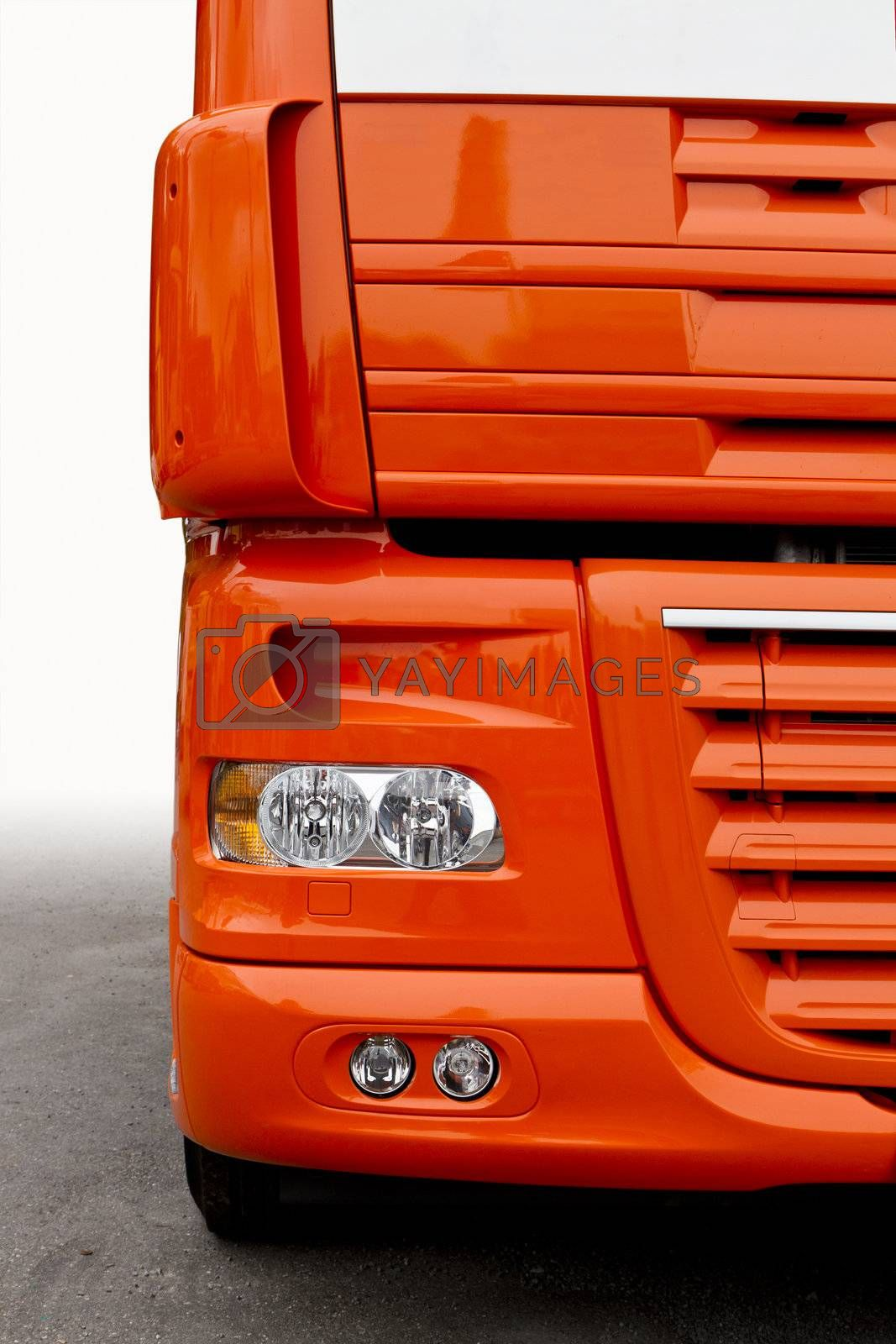 front of orange truck