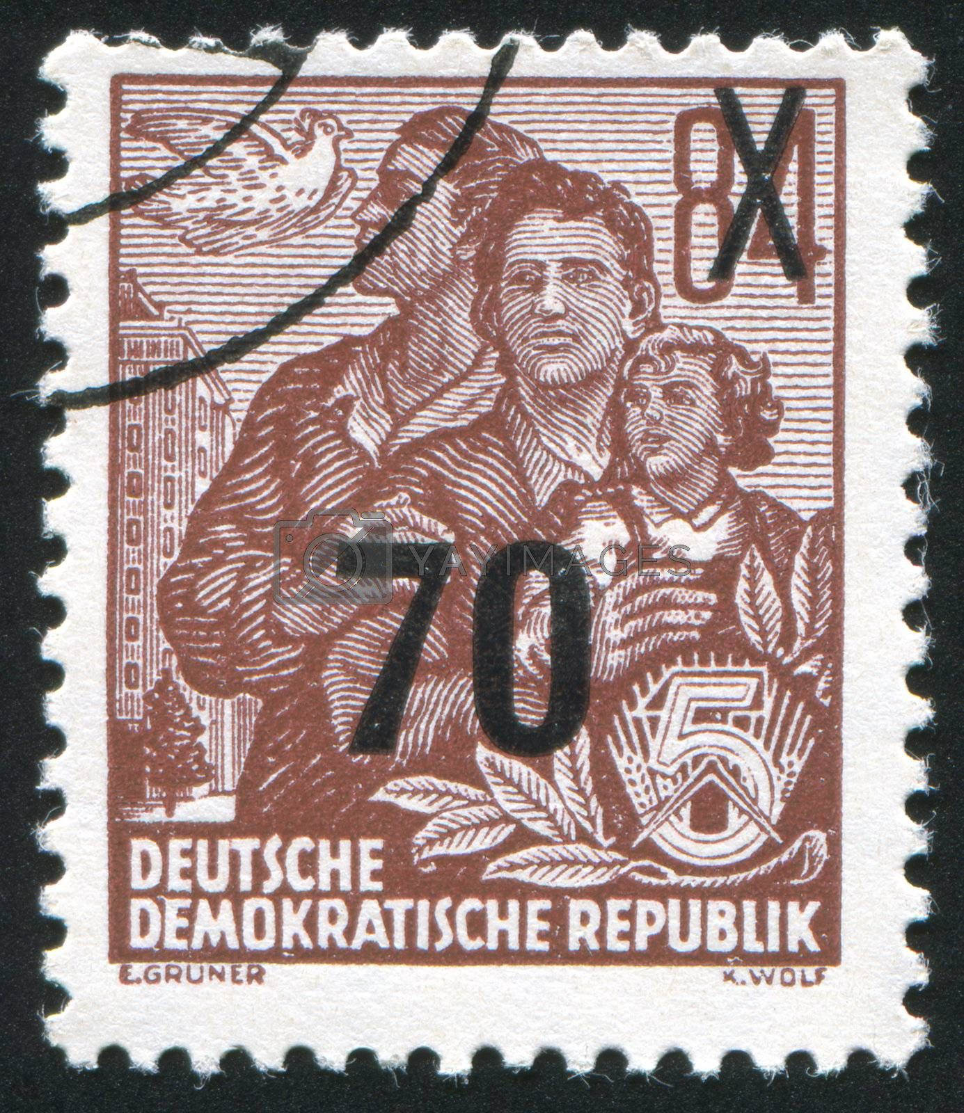 GERMANY - CIRCA 1953: stamp printed by Germany, shows Dove and East German family, circa 1953