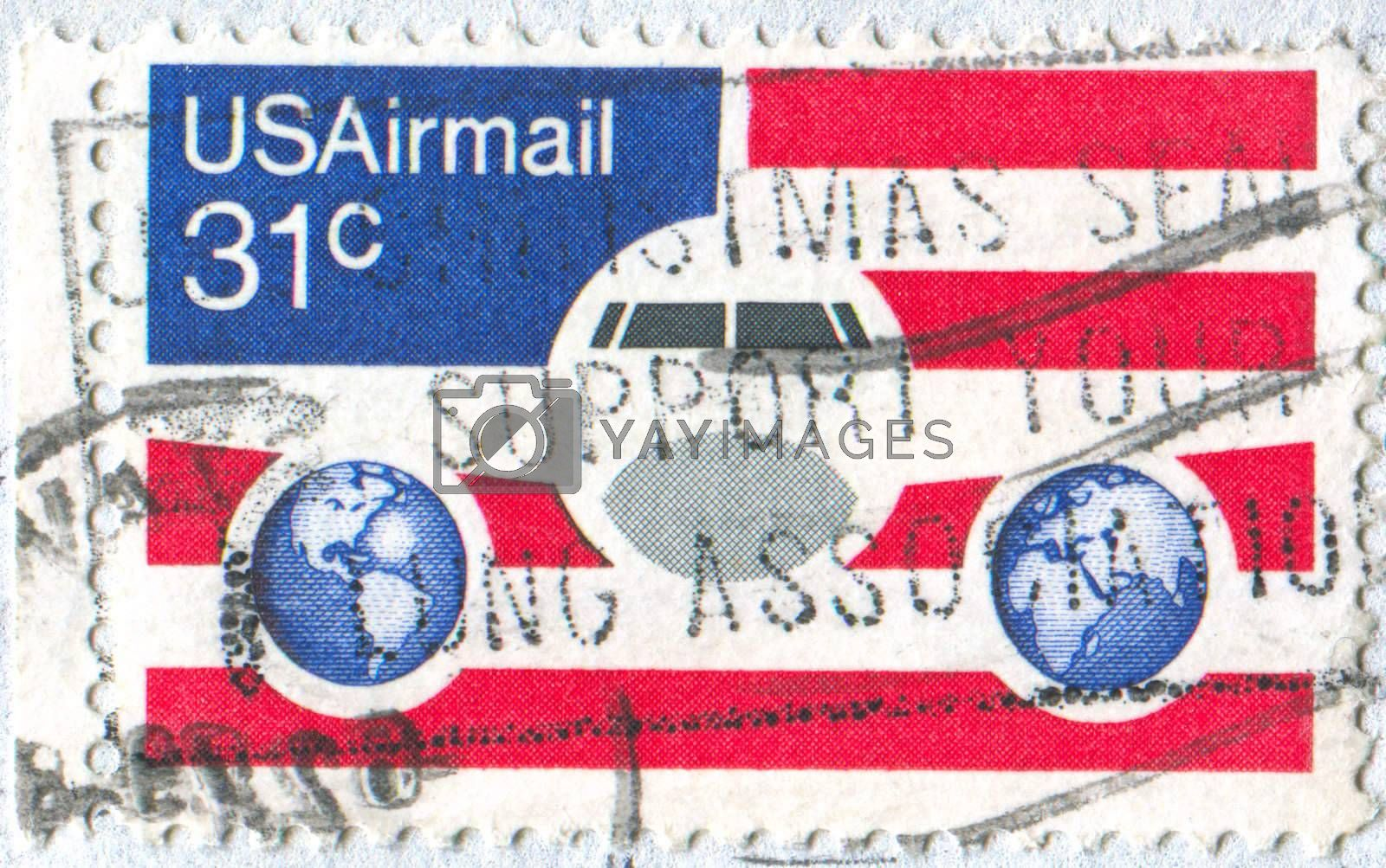 UNITED STATES - CIRCA 1976: stamp printed by United states, shows Plane Globes and flag, circa 1976