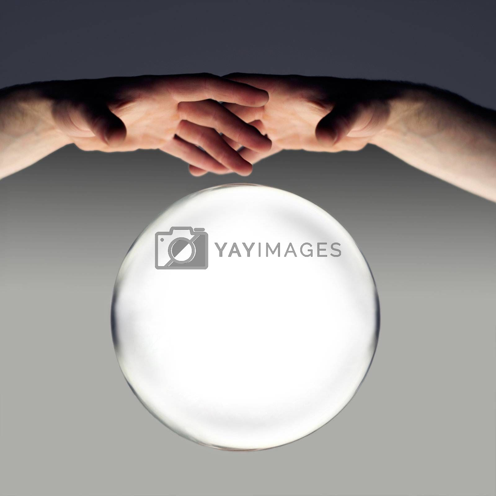 hands over a crystal ball of fortune with a clipping path