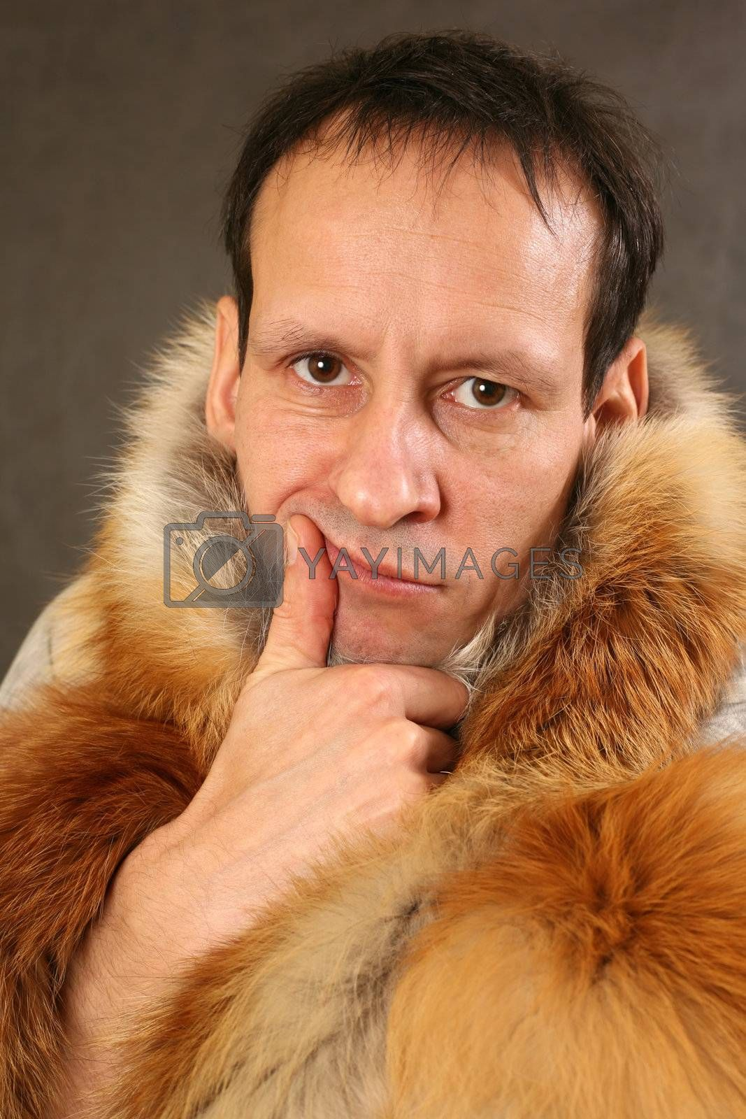 Portrait of the man in the fox fur coat
