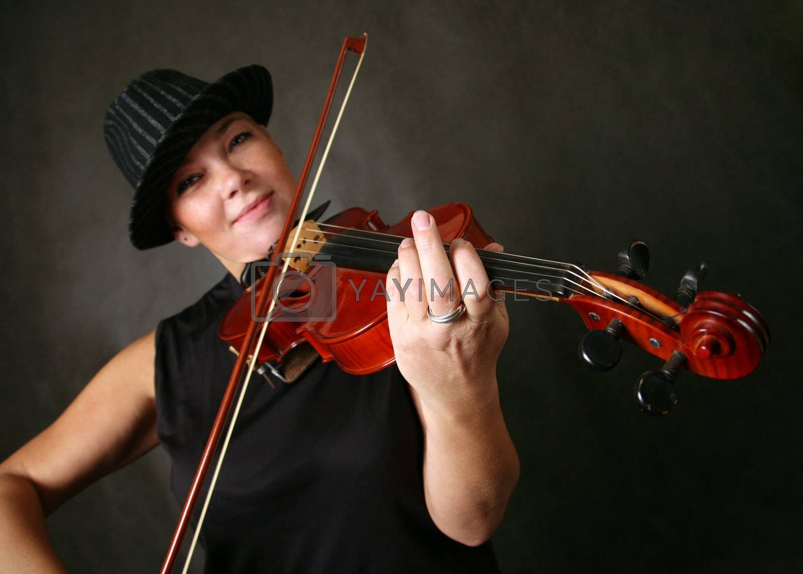 The woman in a hat, playing its violin with a smile