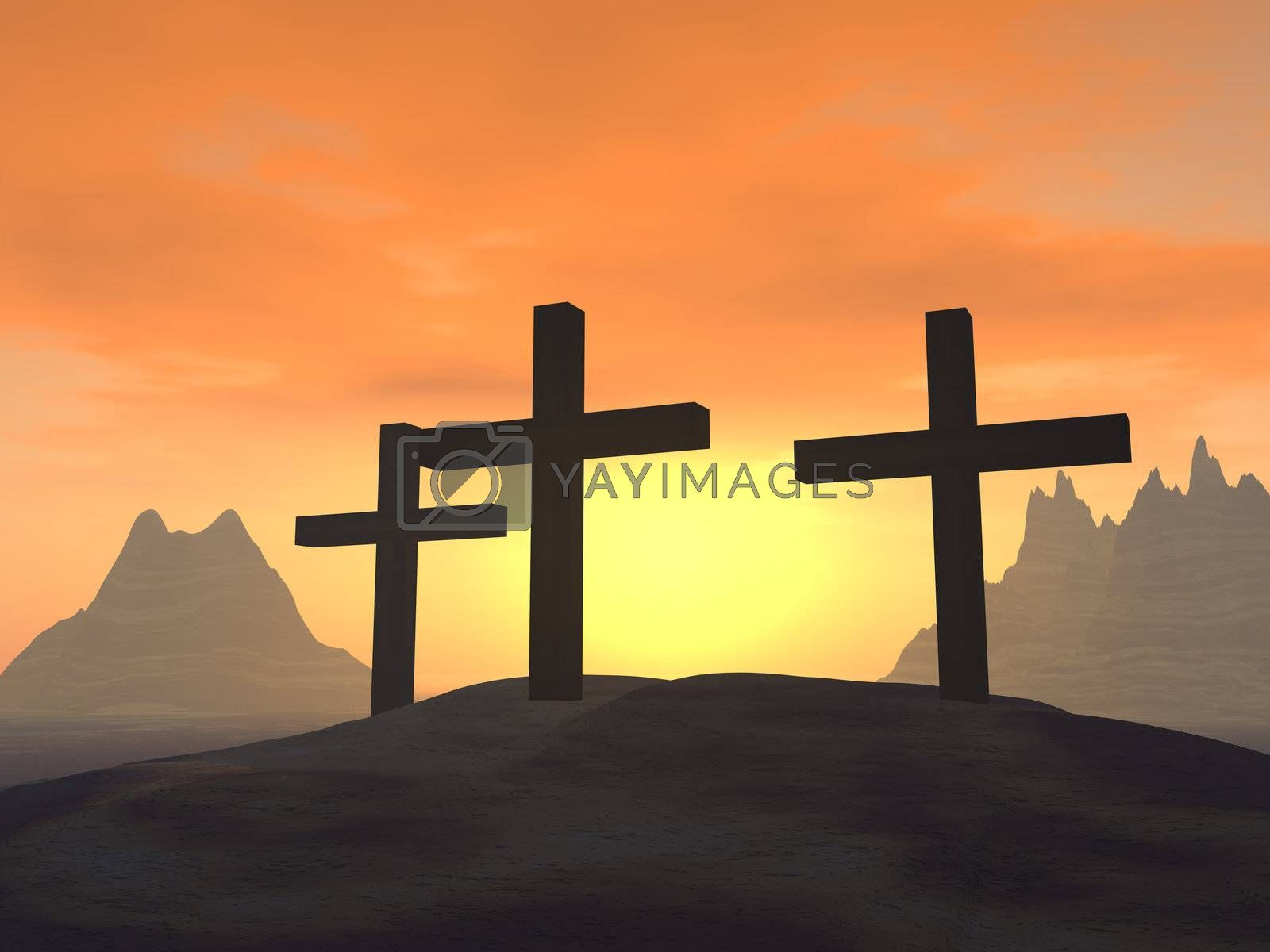 Three crosses on a hill on a background of a sunset