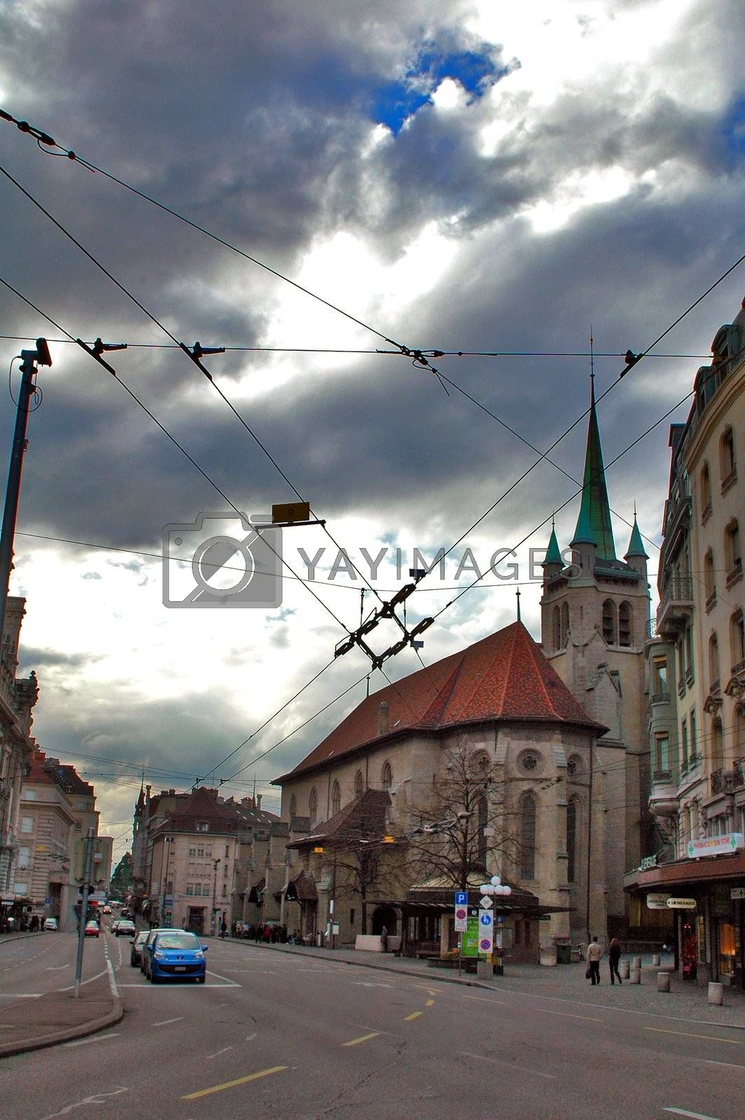 Street scene in Lausanne, Switzerland including a church.