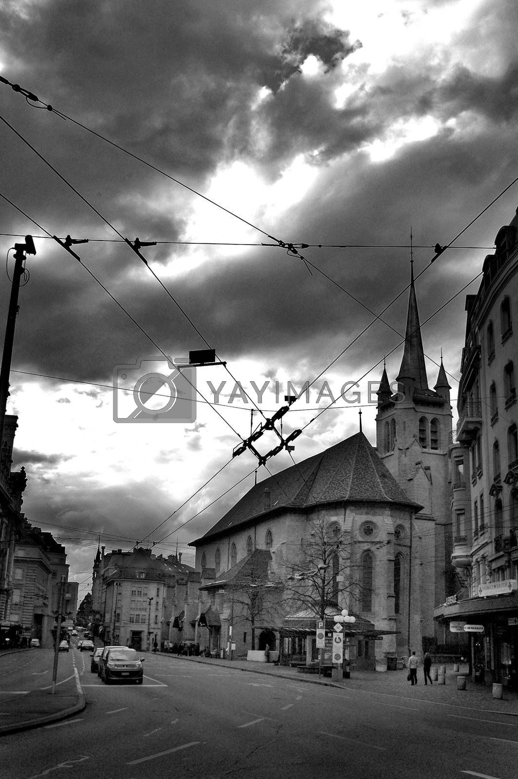 Street scene in Lausanne, Switzerland including a church in black and white.